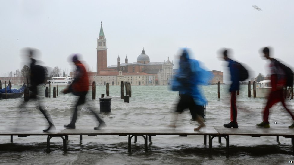Walking on water - duckboards in St Mark's Square during acqua alta high tide