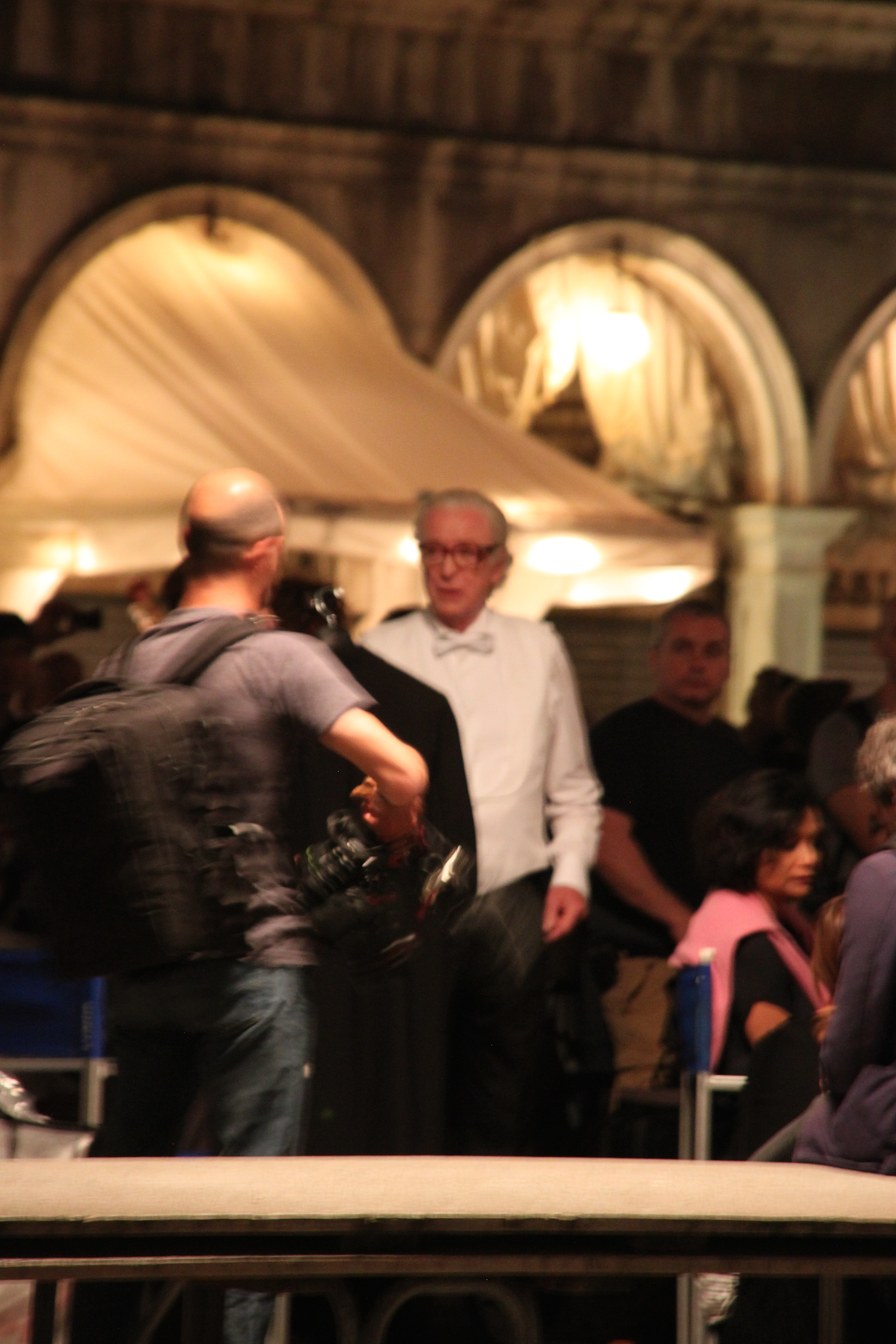 (A slightly fuzzy) Sir Michael Caine suited and booted with a white bow tie ready to shoot the next scene in Il Giovinezza, St Mark's Square, Venice, Italy