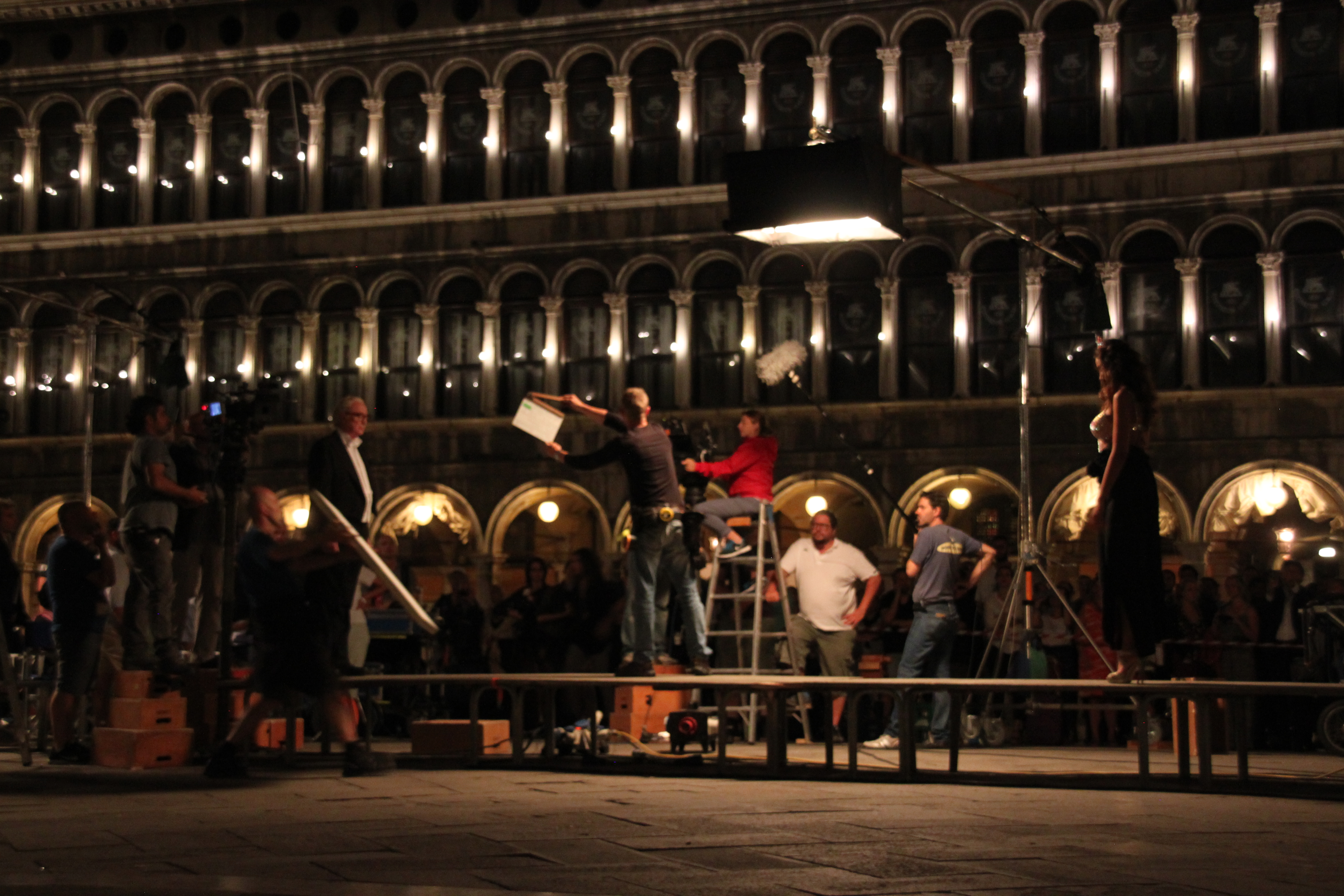 Actors Madalina Ghenea & Michael Caine take their places on a catwalk through St Mark's Square as they film scenes for Il Giovinezza in Venice, Italy. Take 1.