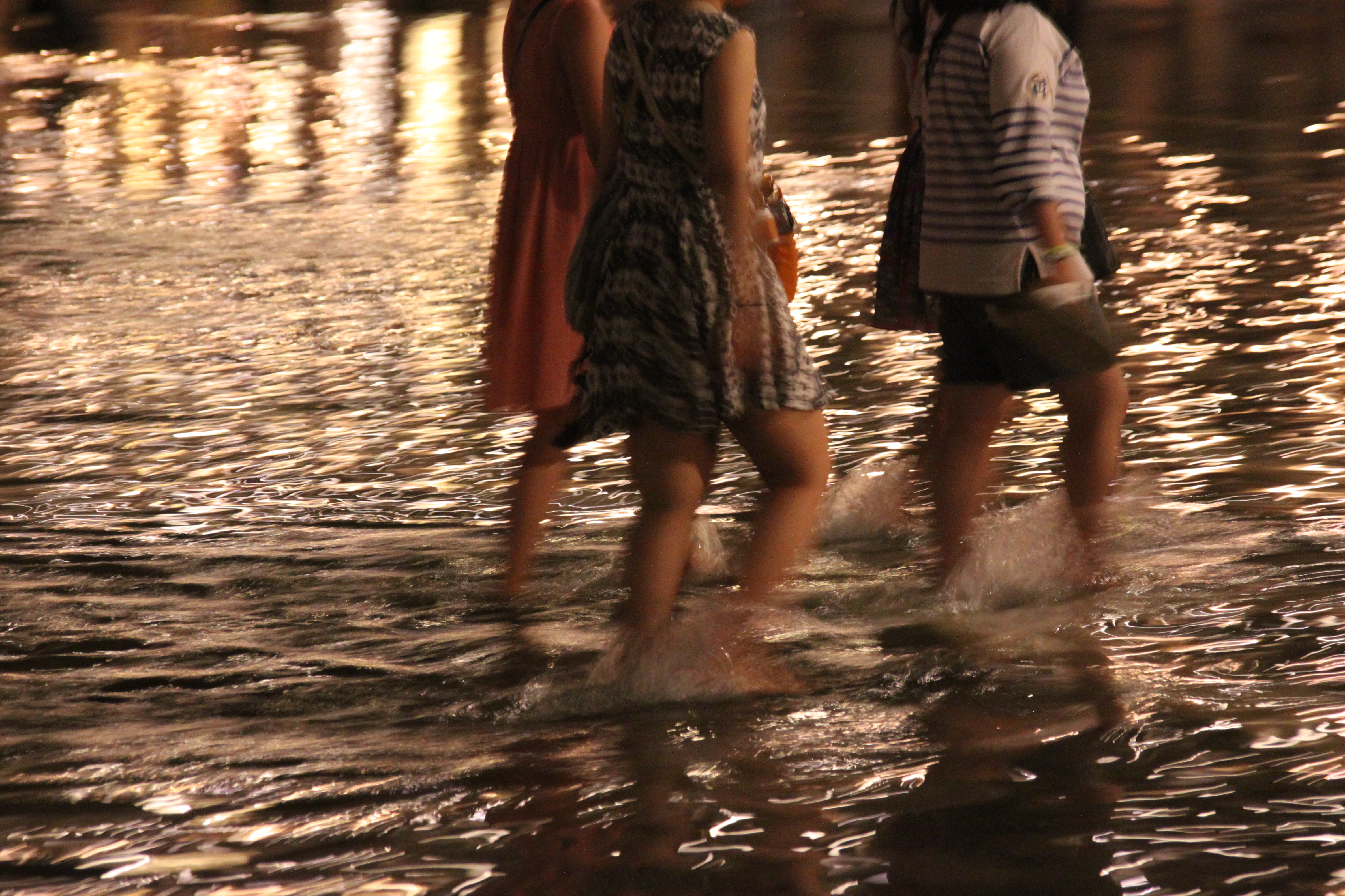 Wading through floodwaters in Venice