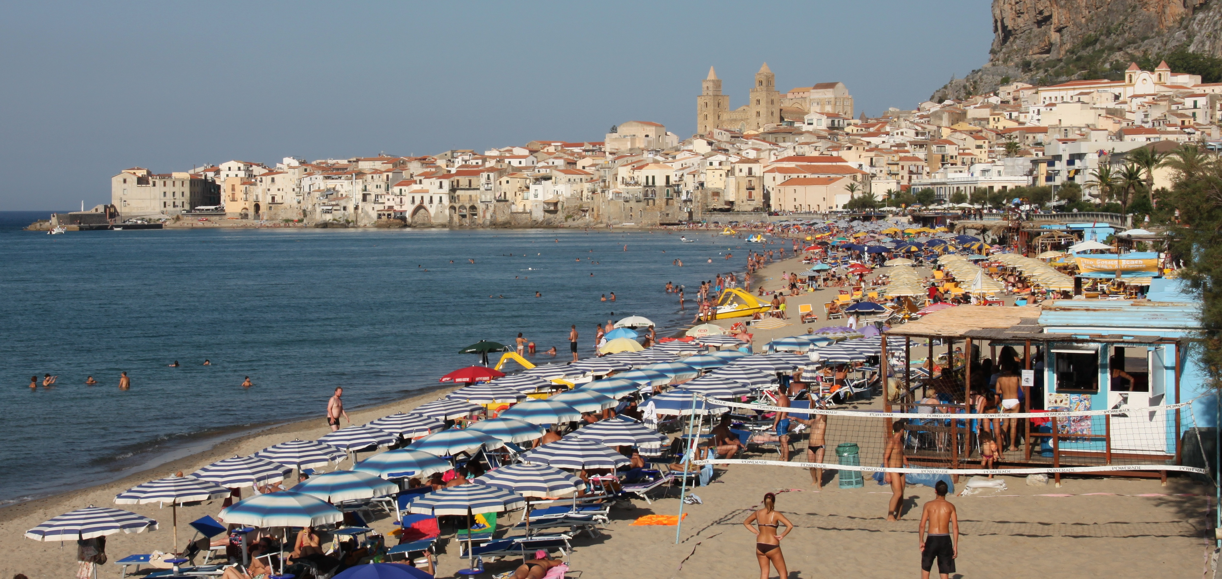 Sun, sea and sand on August holidays in Cefalù, Sicily