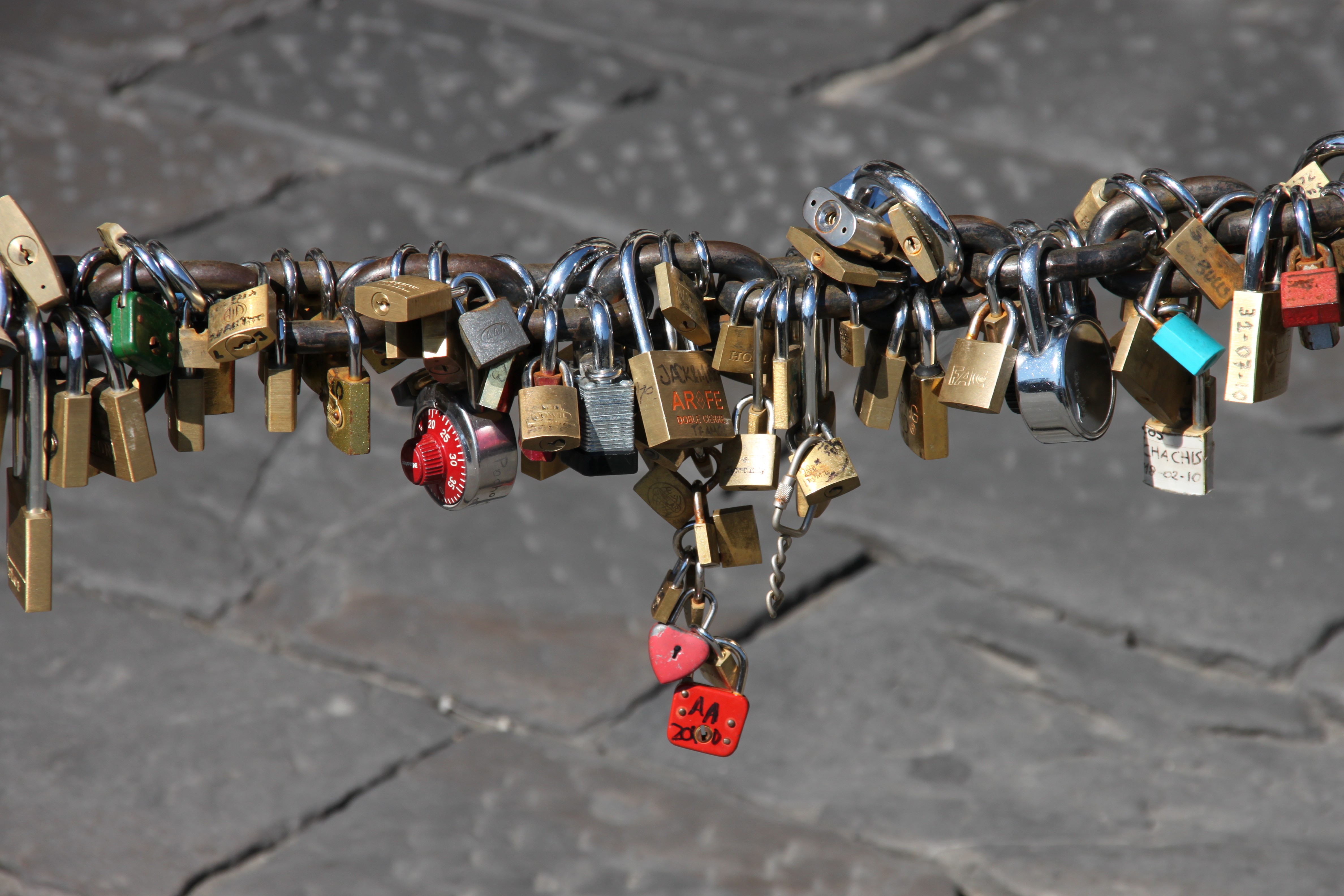 Lovelocks locked onto a pedestrian barrier along the Arno, Florence