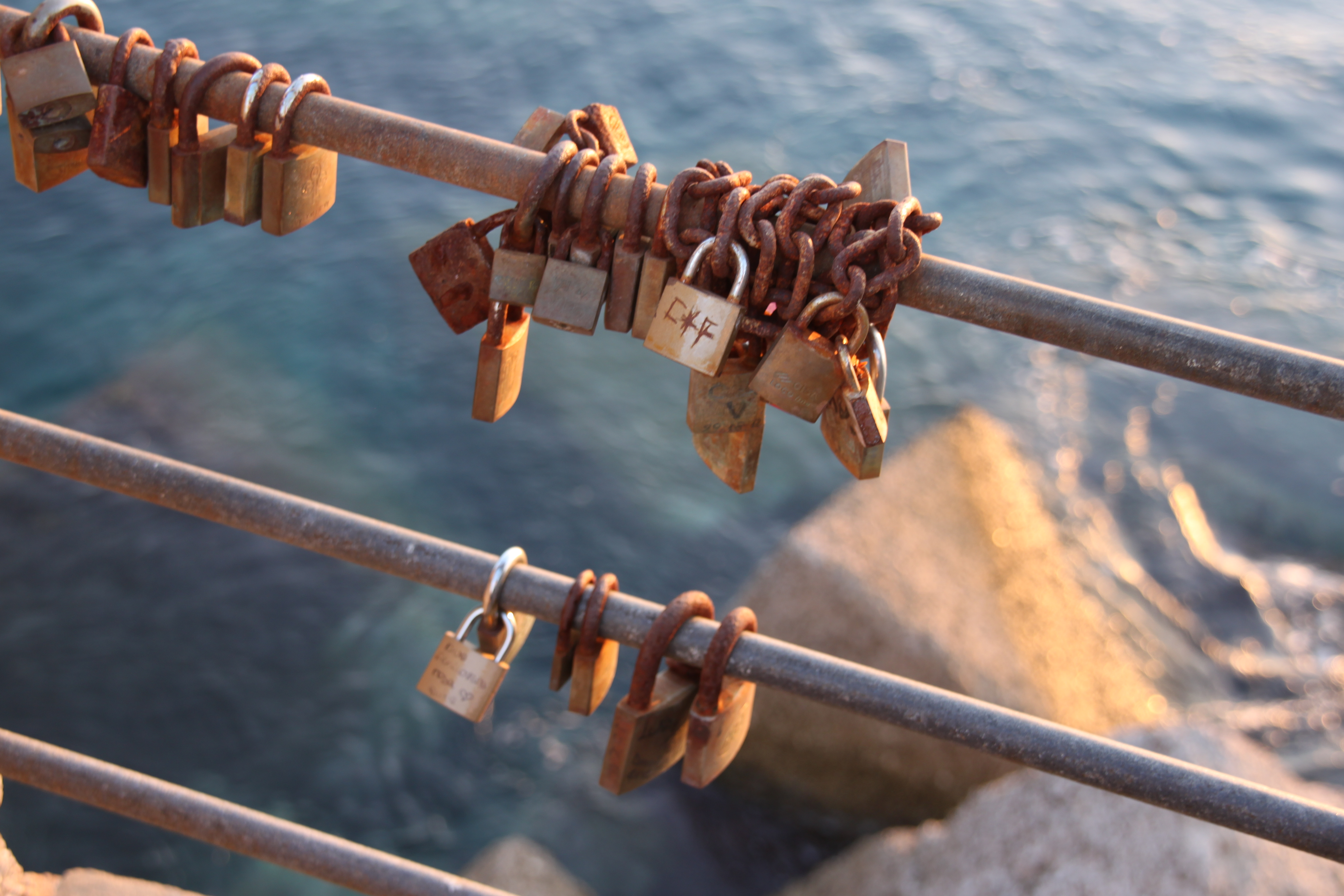 Love locks on the quayside at Cefalù, northern Sicily
