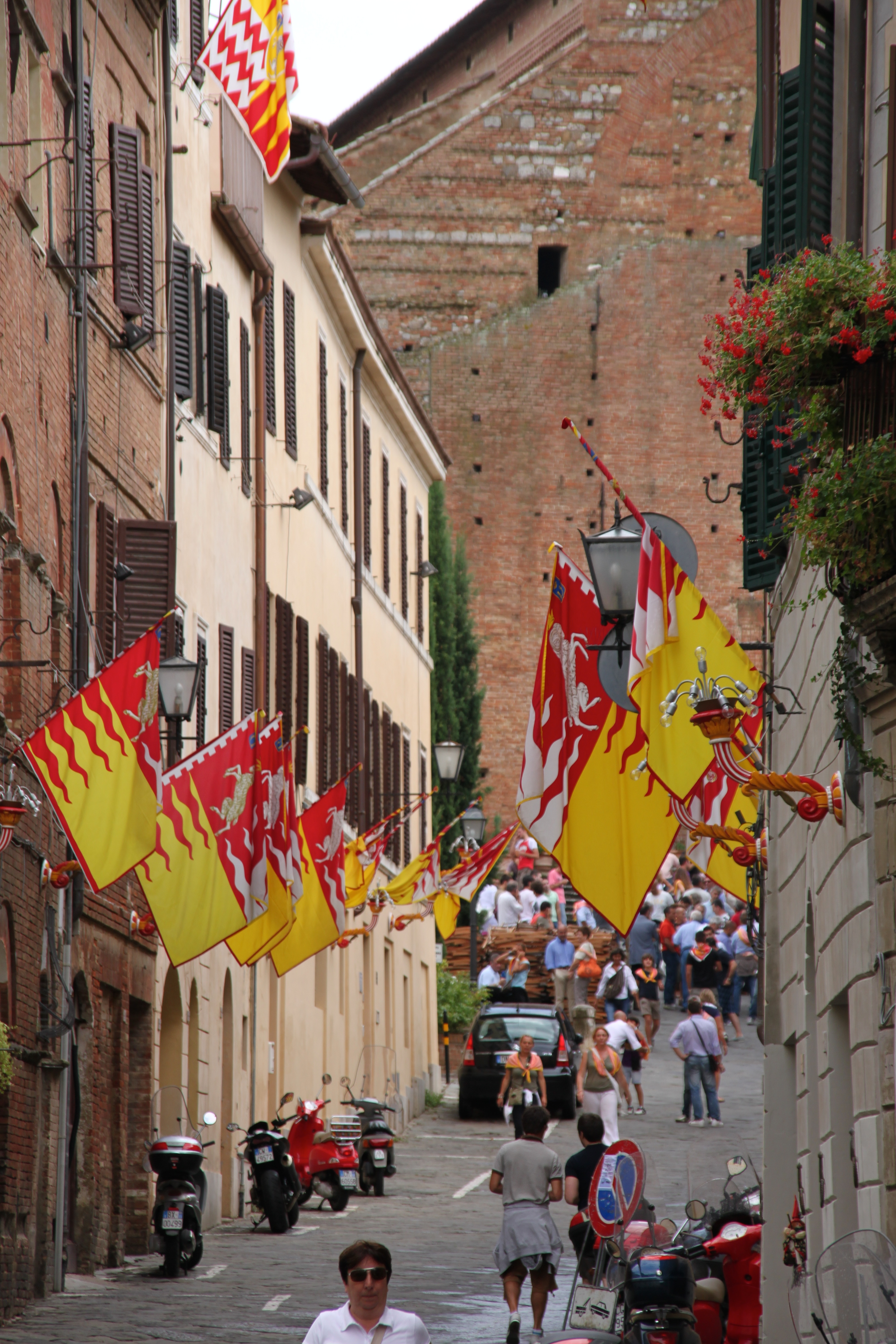 Siena's streets decked in technicoloured flags during the Palio horse race season