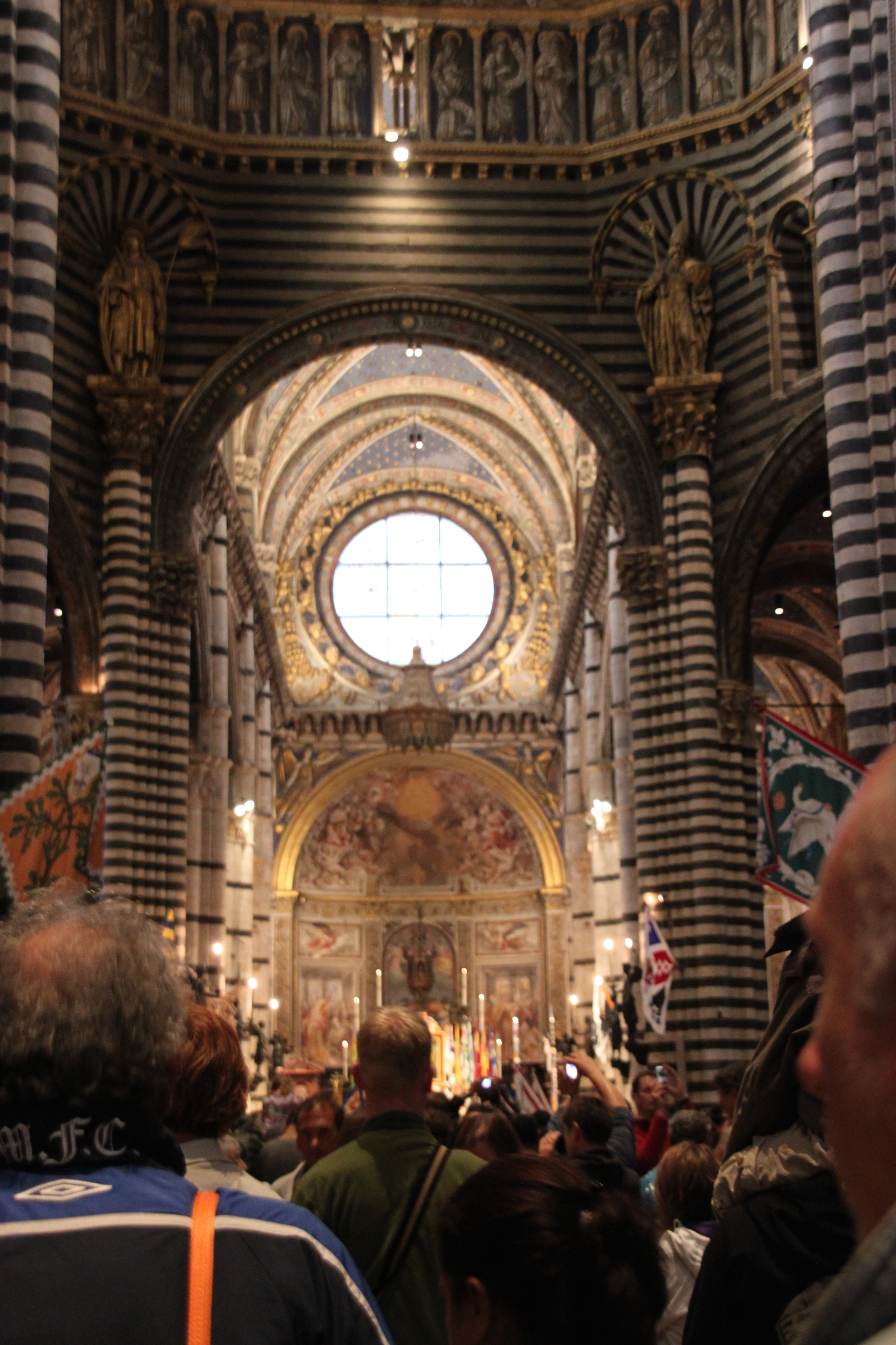 Photo of the ceremony to bless the contradas in Siena's black and white Duomo, August 2010