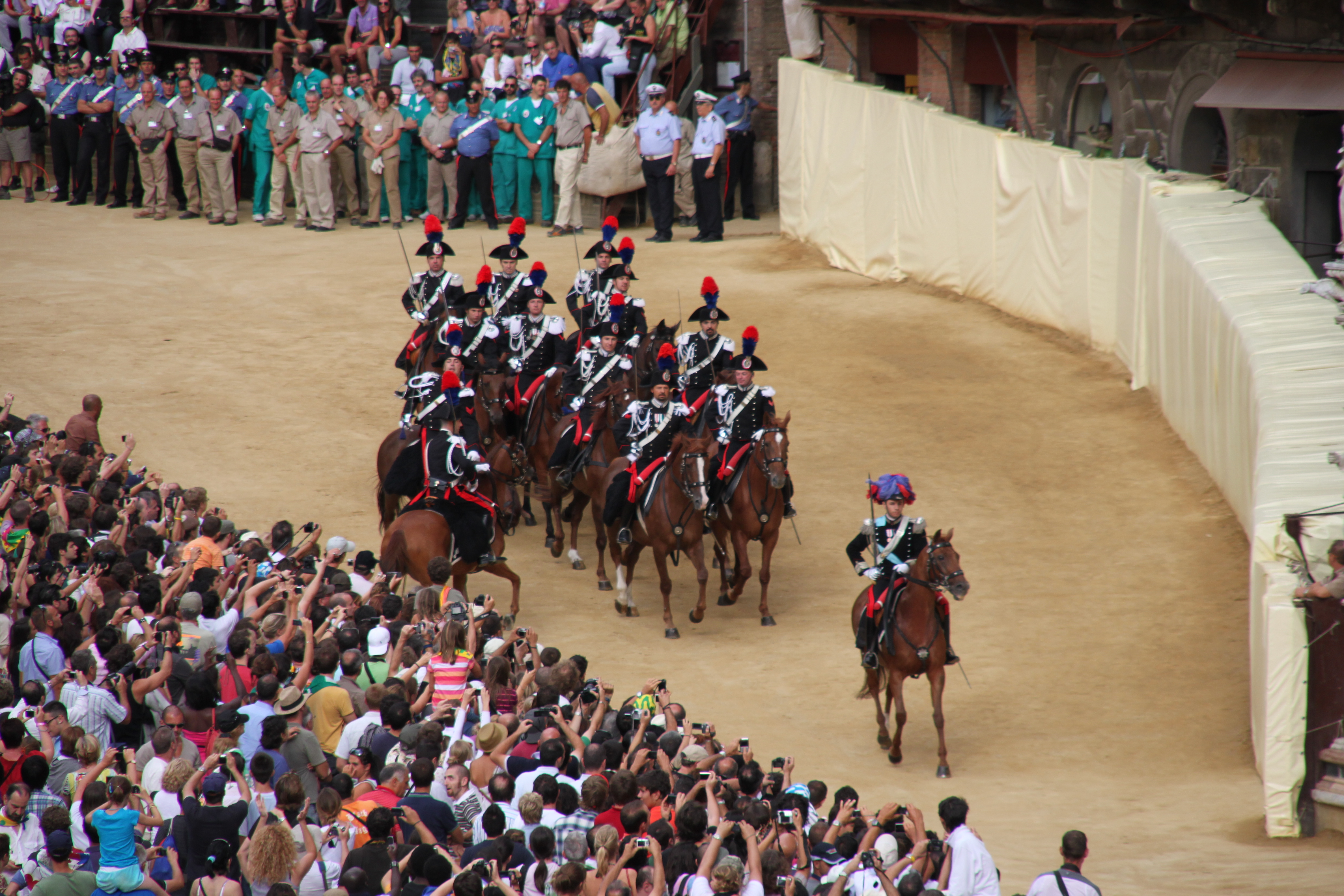 Photo of the horseback cavalry arrives and circuits the race track at a gallop