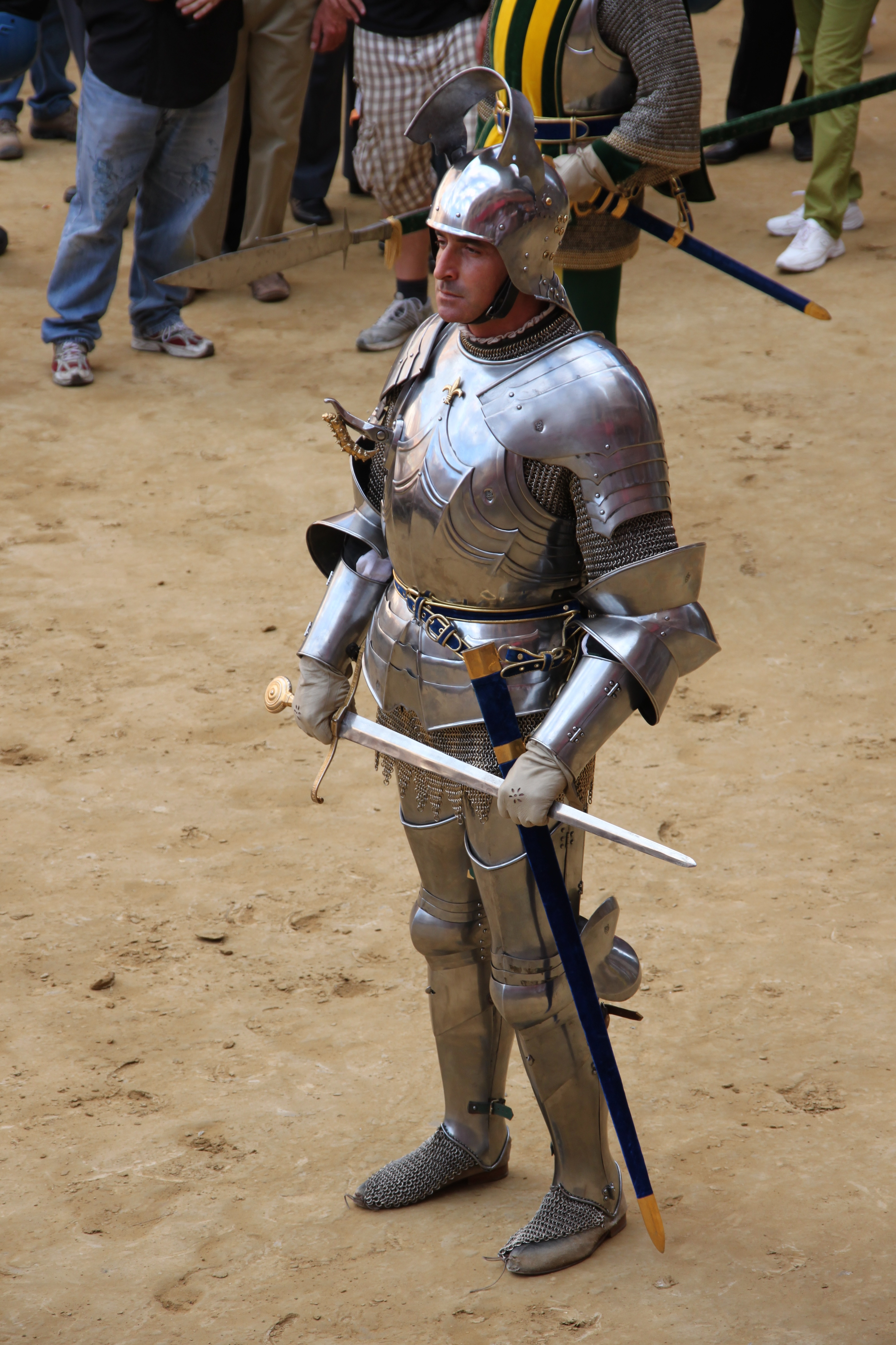 Photo of a Siena citizen dressed as a mercenary for hire in the historic parade before the Palio horse race
