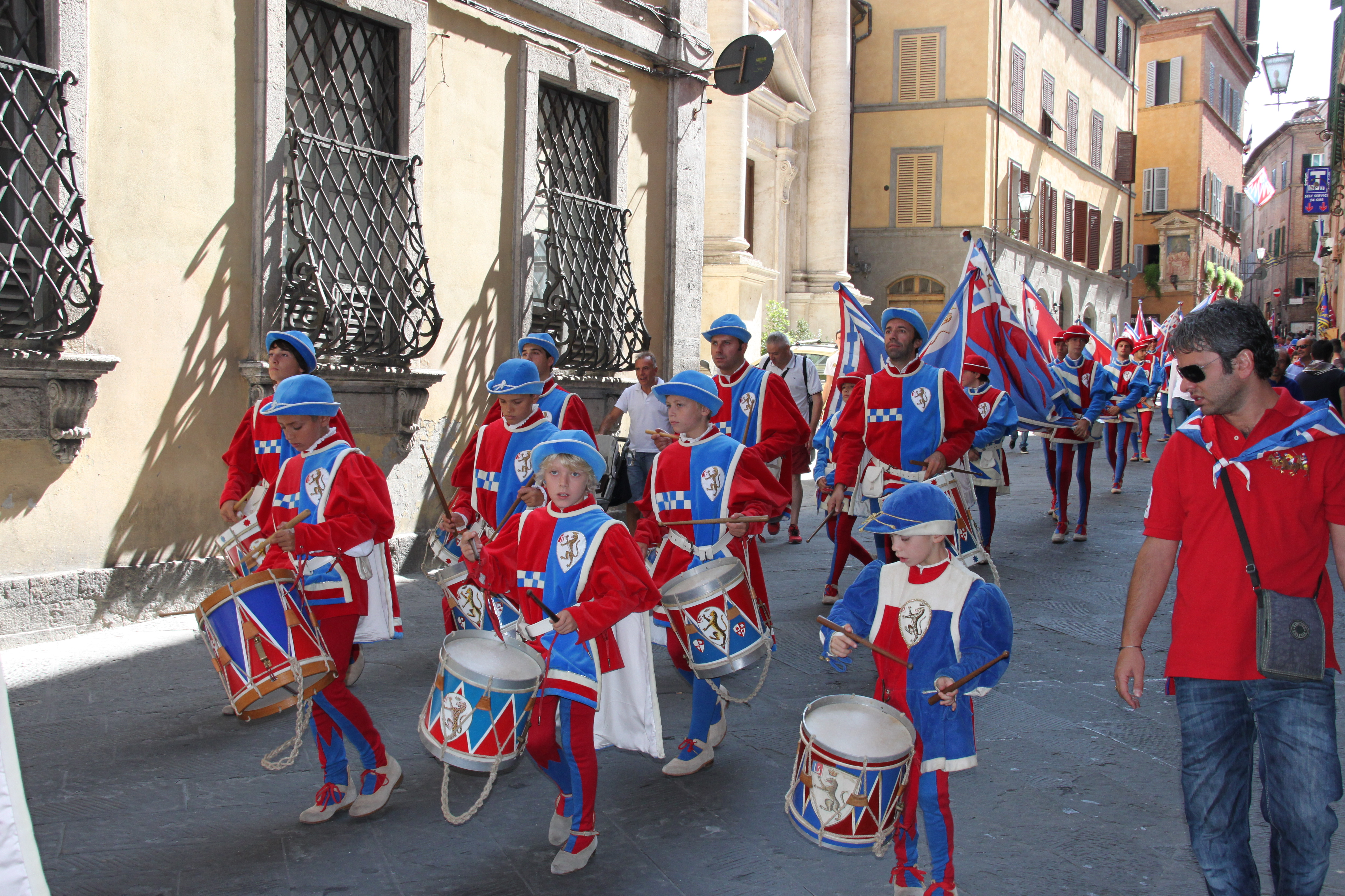 Each summer Sunday a contrada or district will parade around the city with drummers and flag bearers all in medieval costume