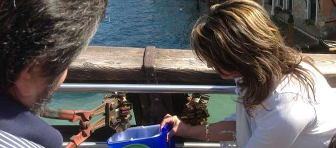 Locals remove lovelocks from the wooden Accademia bridge, Venice