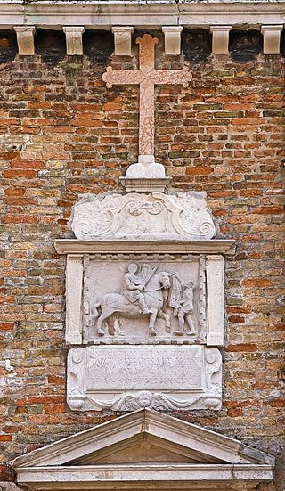 Bas-relief of San Martino on the Church of San Martino in Castello, Venice. Photo from Wikipedia via Creative Commons