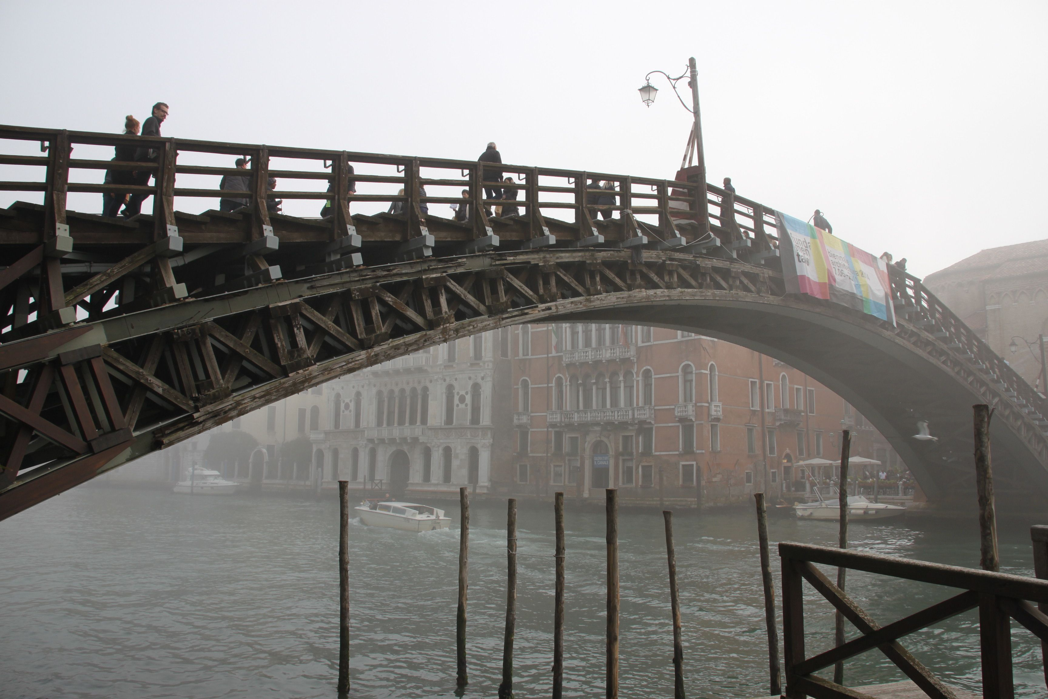 L'Accademia Bridge rises out across the misty Grand Canal