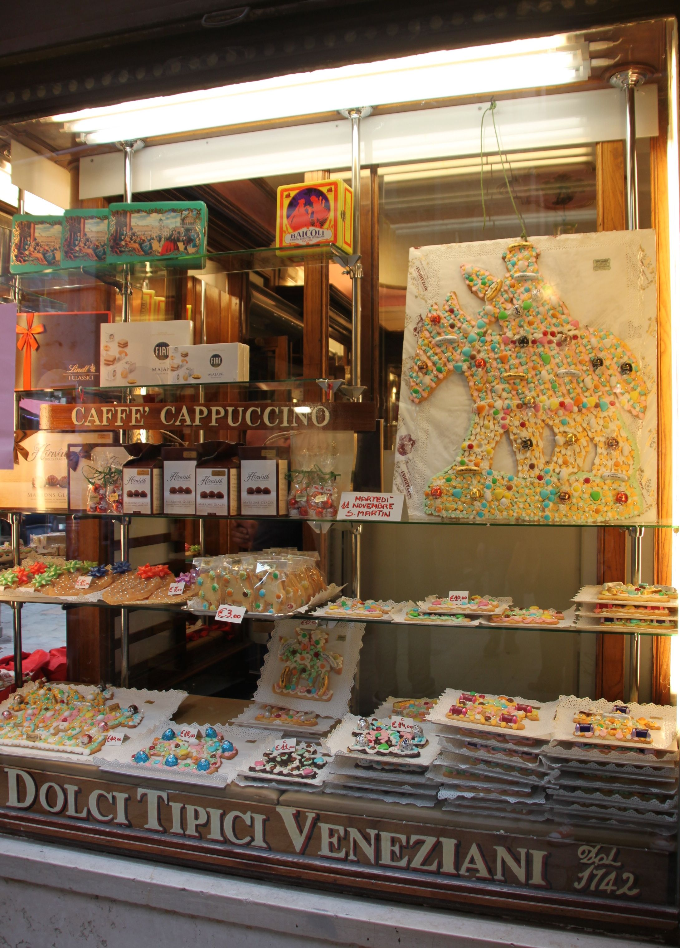 Pasticceria Rizzadini's windows are full of San Martino biscuits