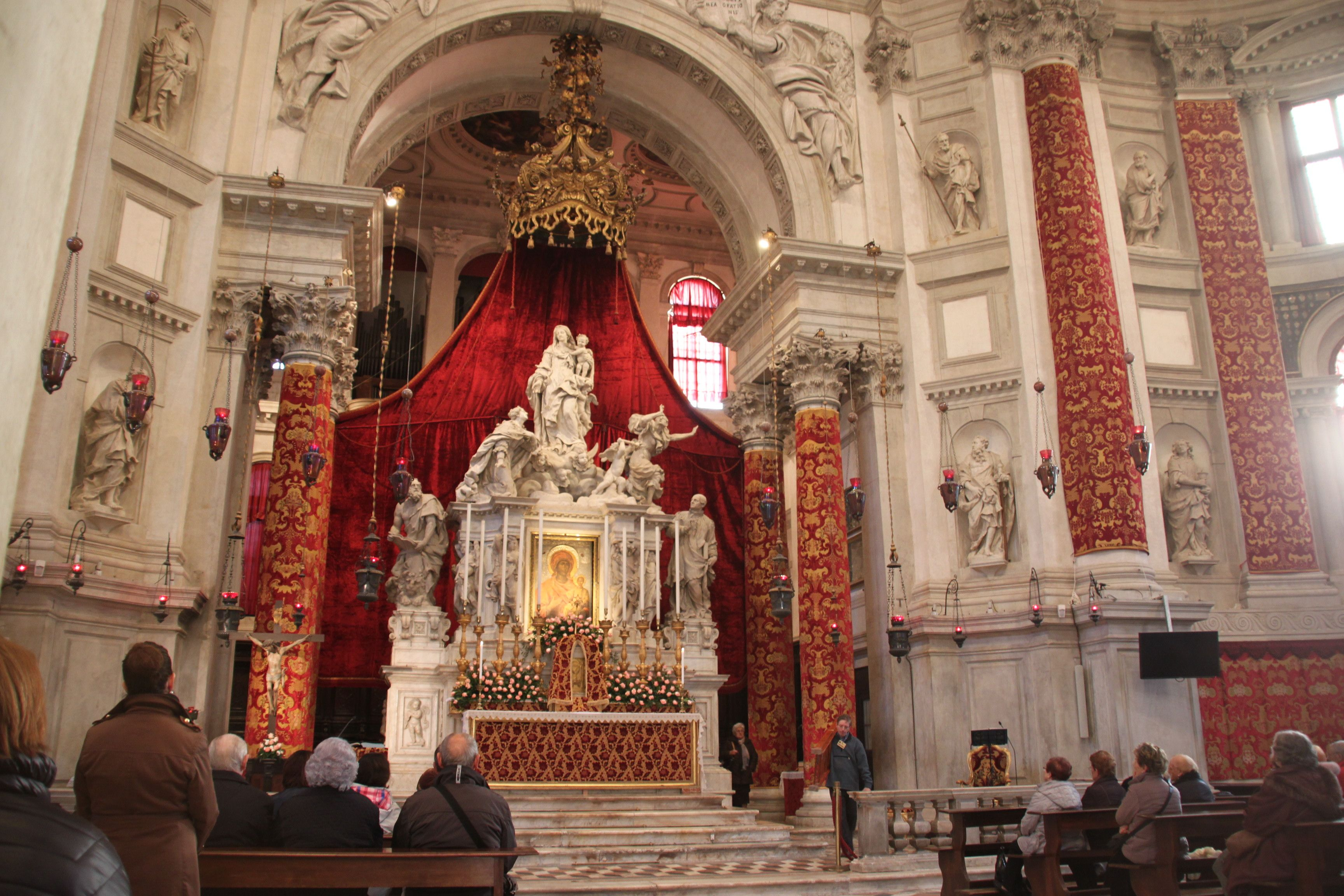 The high altar of the church of the Madonna della Salute with the golden icon of the Madonna at its centre