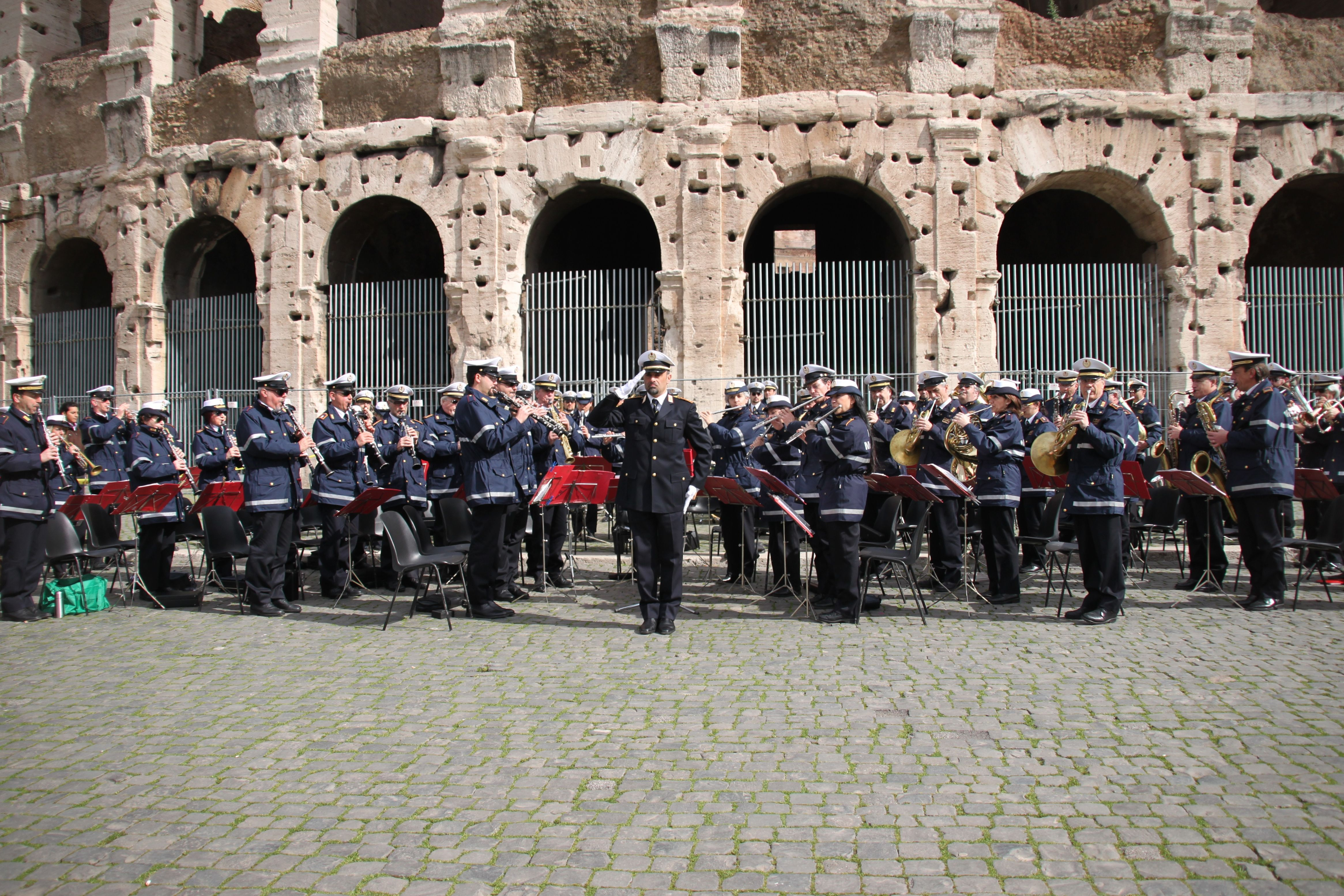 The Polizia Municipale Brass Band playing in front of the Colosseum