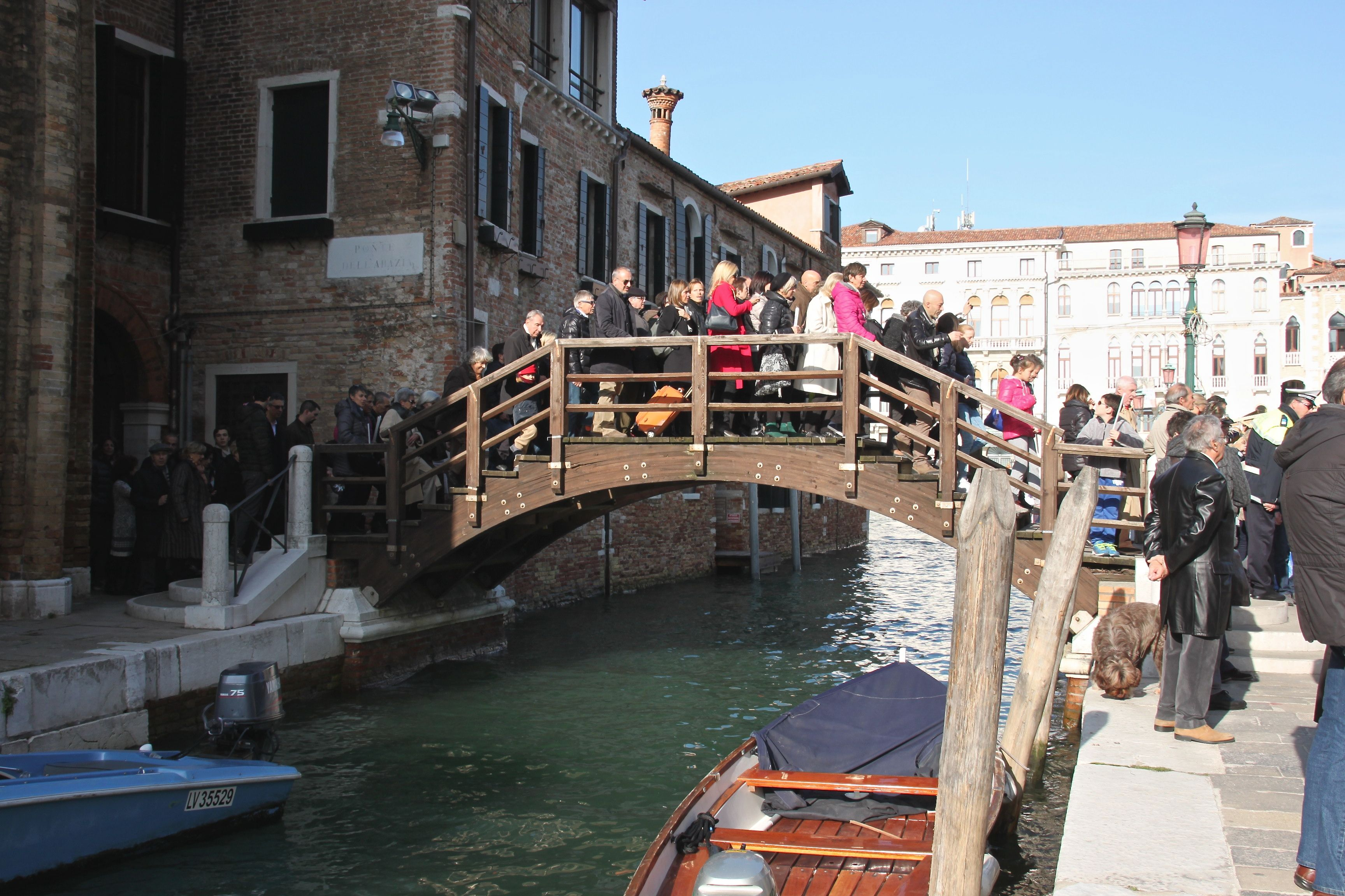 The faithful make the short pilgrimage to the Church of the Madonna della Salute on foot