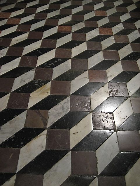 Geometric optical illusion - details of the marble mosaic floor of Siena Duomo, Tuscany