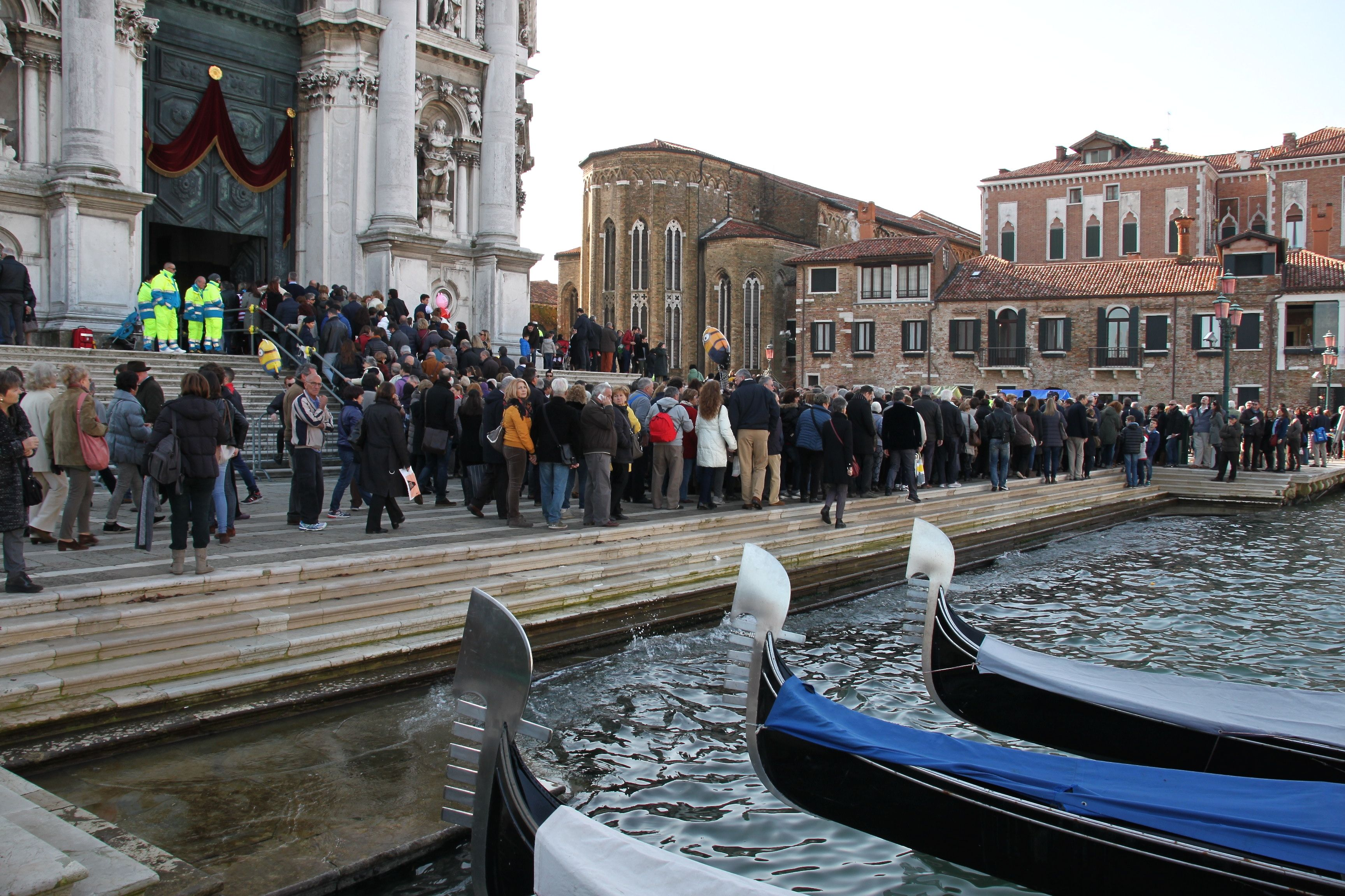 Worshippers gather on the Salute's waterfront before entering the church