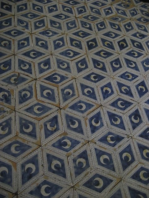 Beautiful blue geometric details of the marble mosaic floor of Siena Duomo, Tuscany