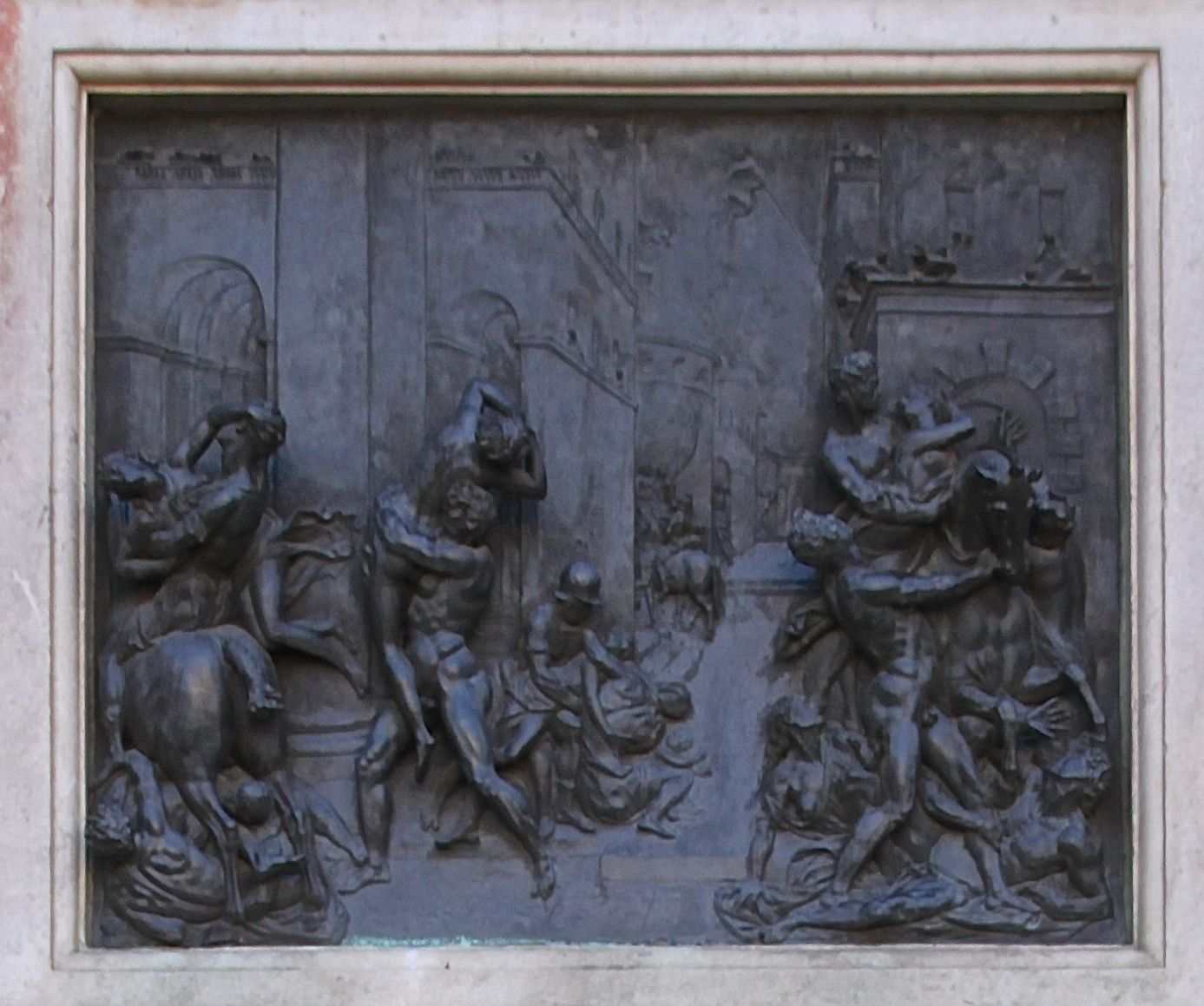 Bronze plaque around the base of the statue