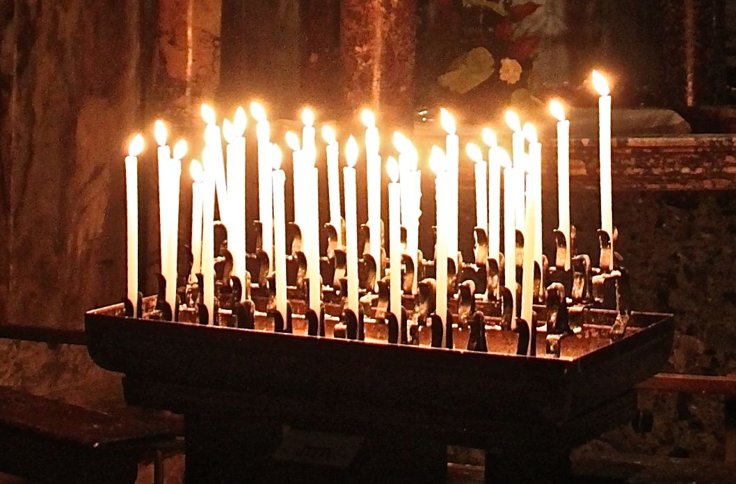 Candles lit in prayer in St Mark's Basilica