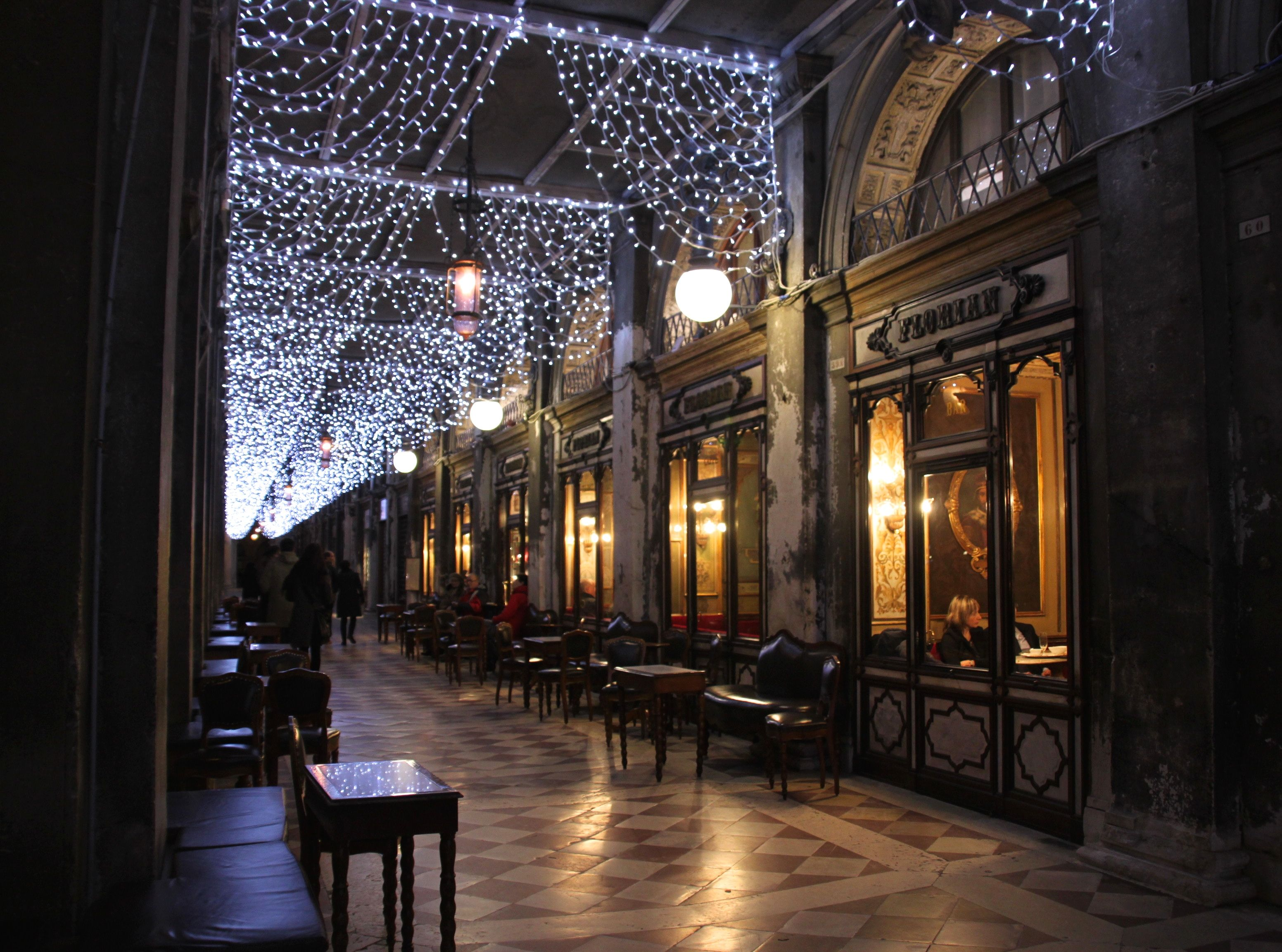 Christmas lights in the colonnade of St Mark's outside the Florian Cafe