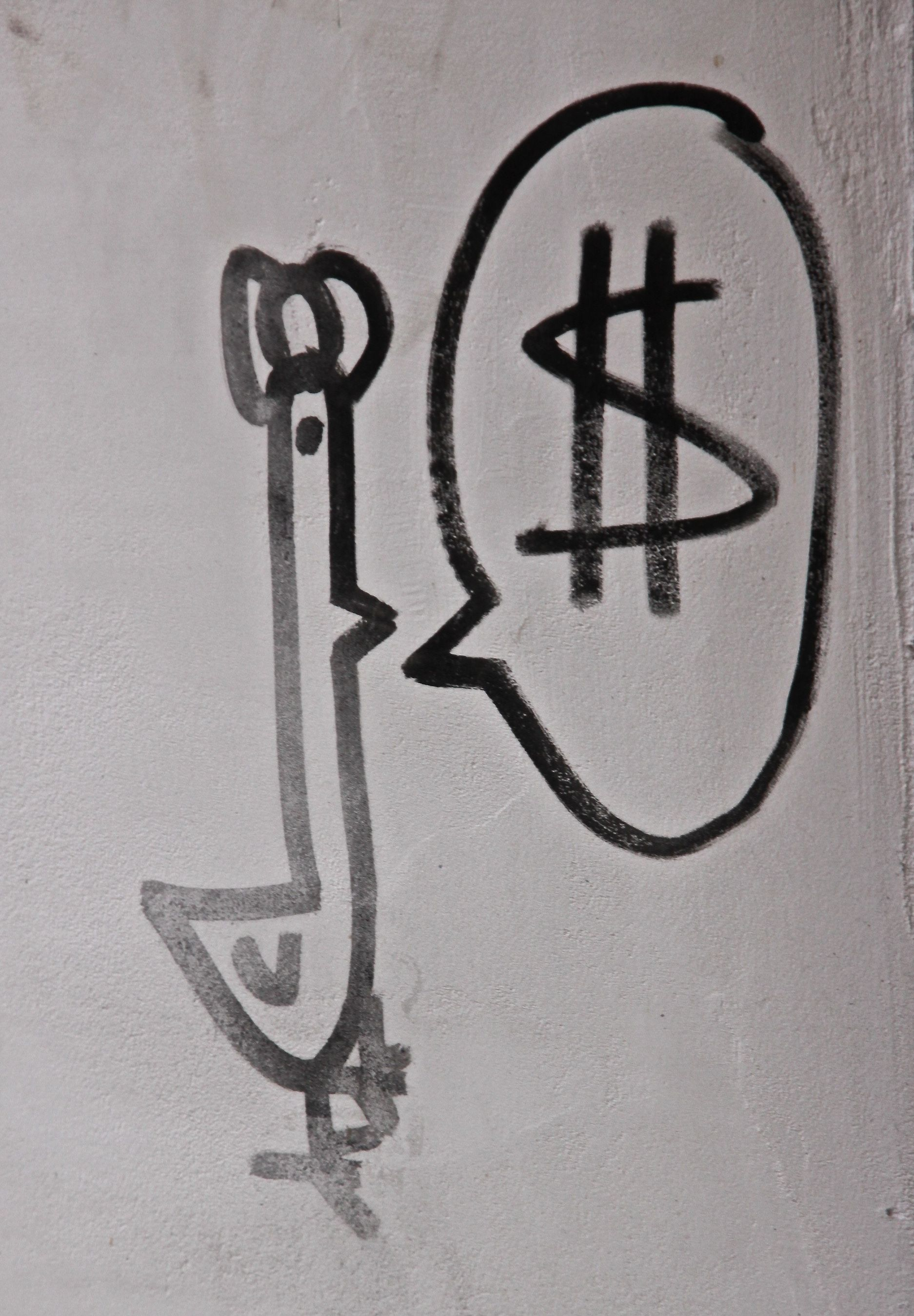 Graffiti spotted on the side of a bank in Venice, presumably commenting on the economic crisis