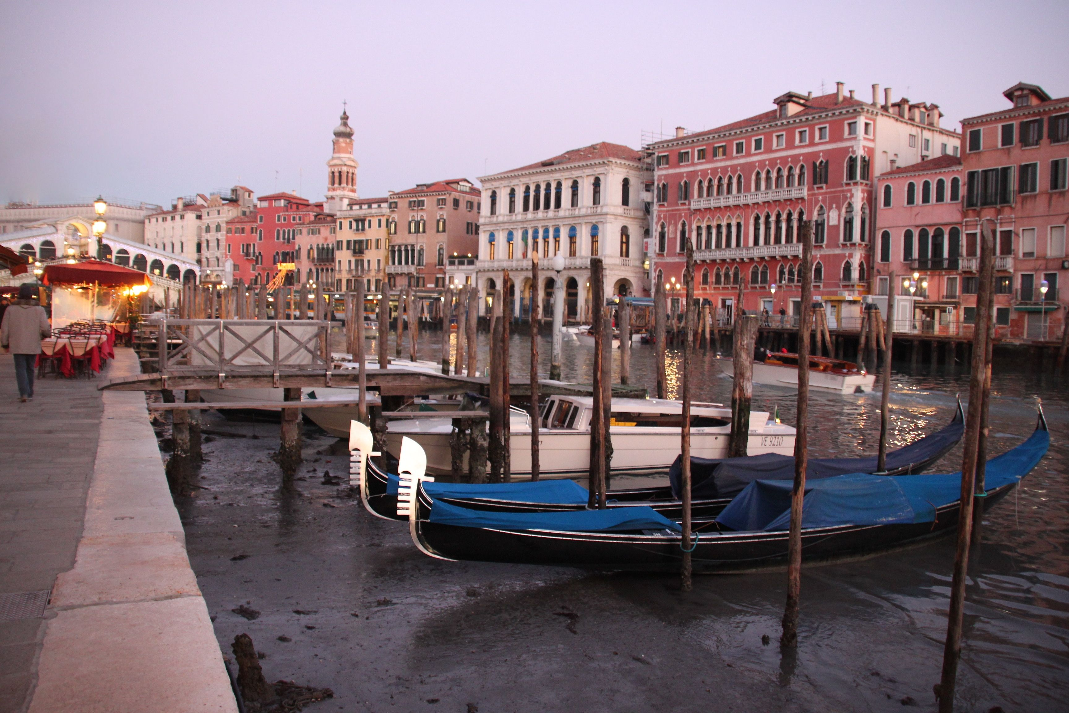 Gondole beached on the muddy Grand Canal