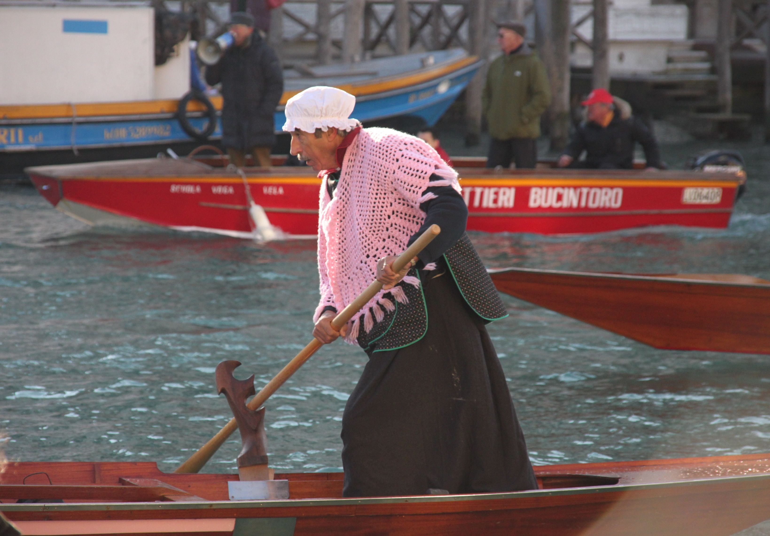 Befana rows down the Grand Canal