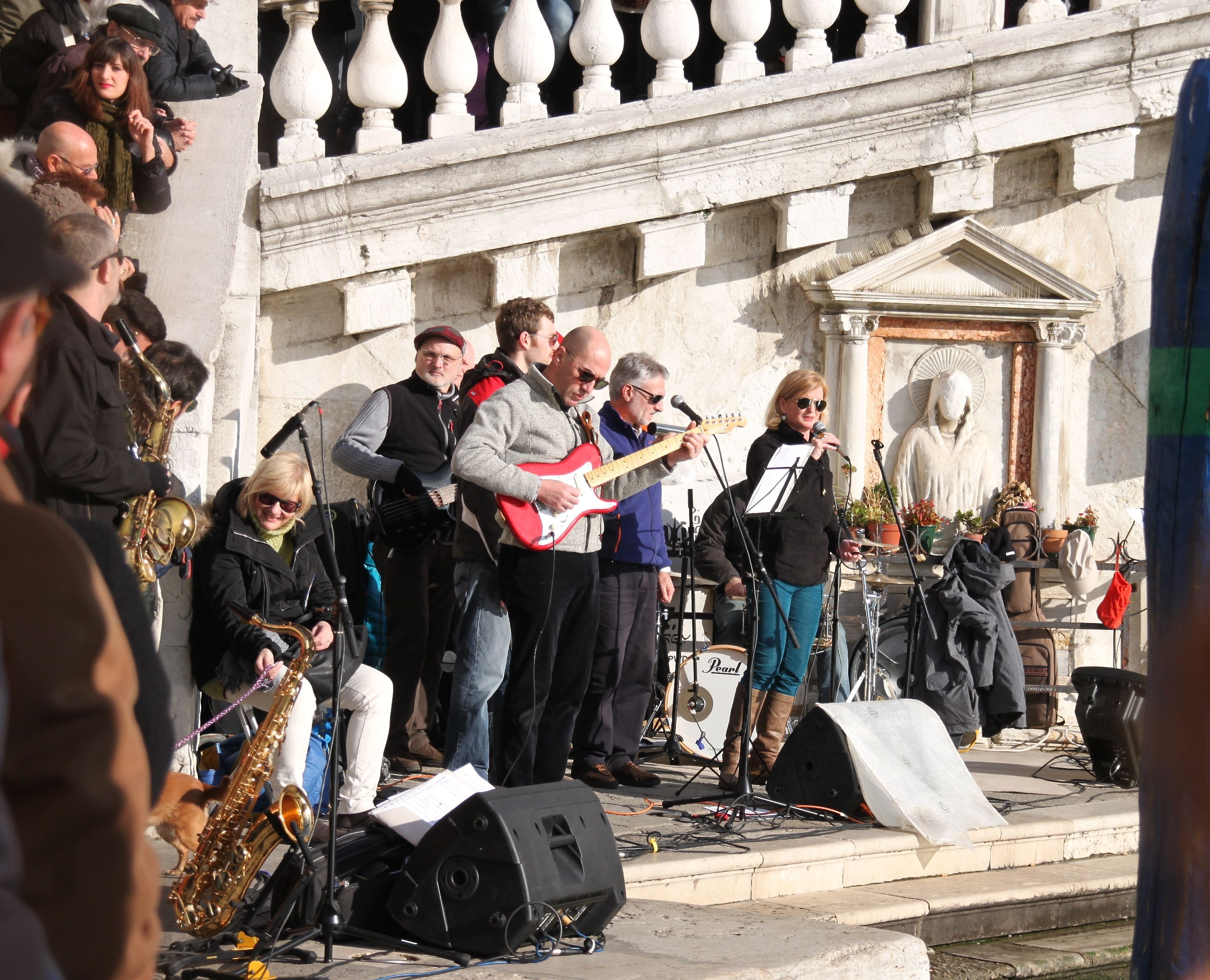 The band plays on the canal side under the Rialto Bridge