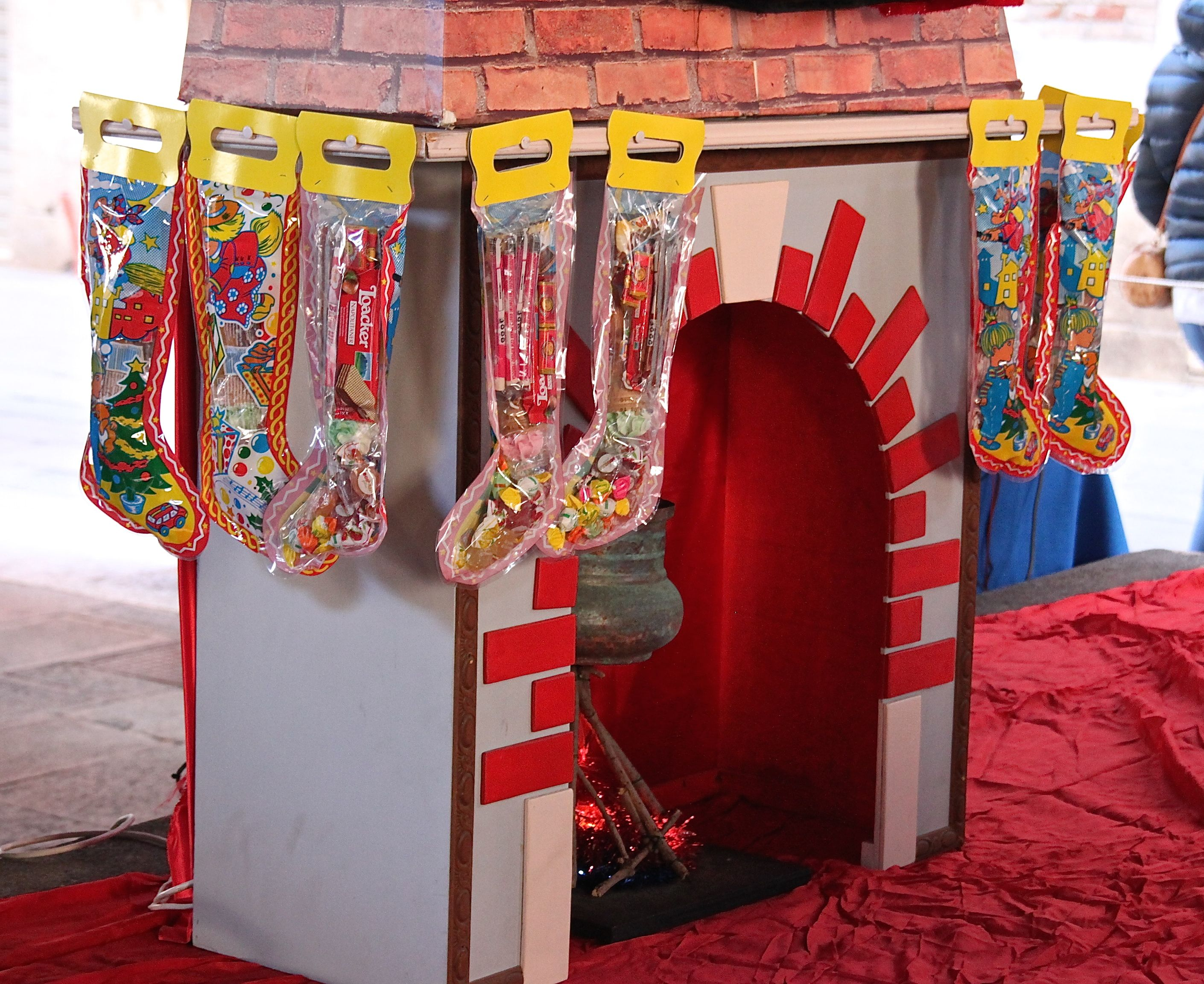 A chimney with stockings filled with sweets