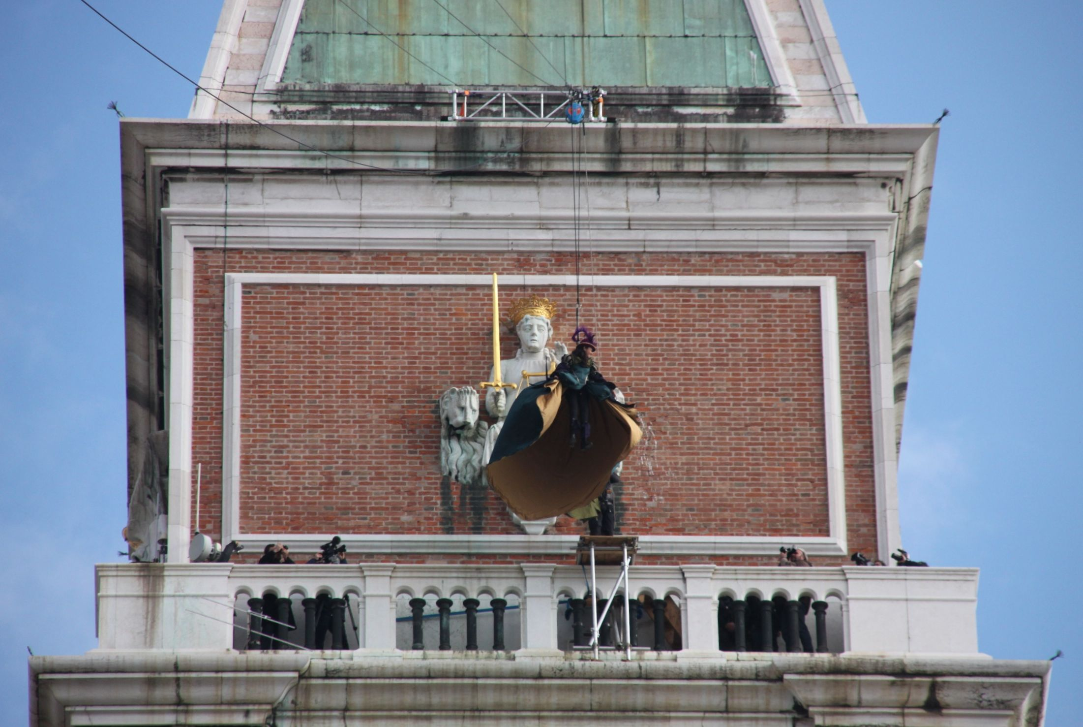 Venice's carnival eagle launches out above the parapet of St Mark's campanile