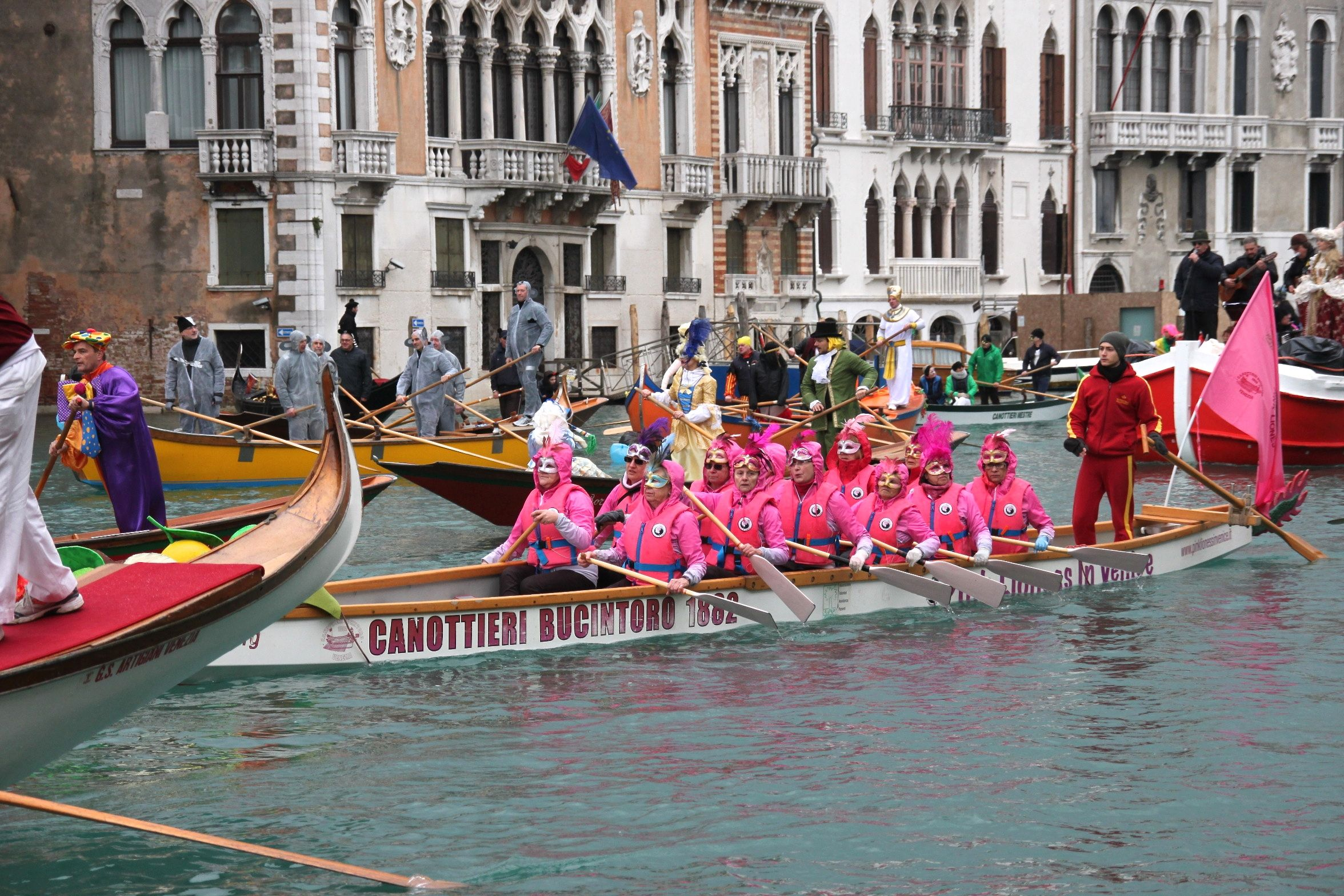 Venice Carnival Water Parade - Venice's pink lioness dragon boat rowers - all breast cancer survivors
