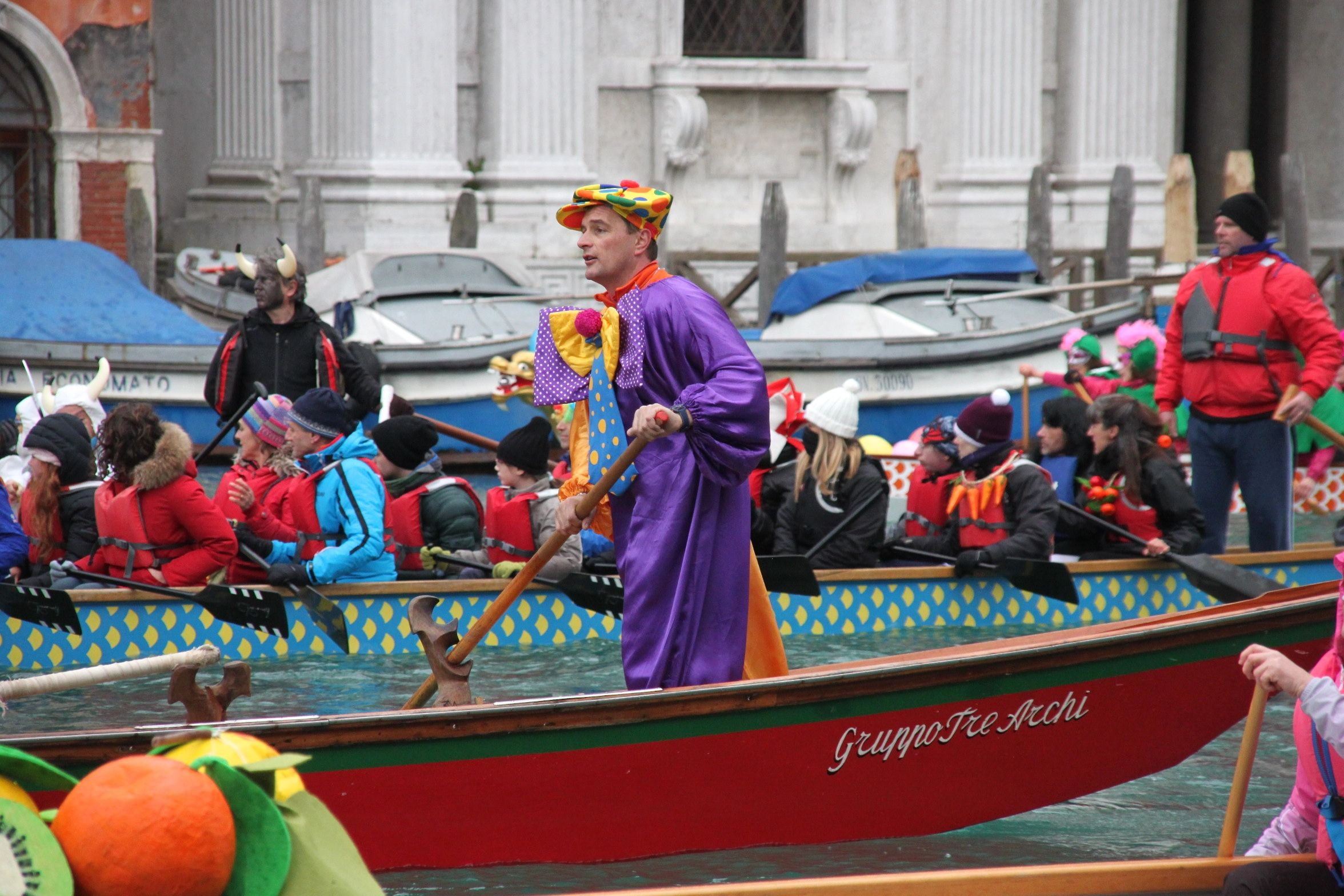 Venice Carnival Water Parade - A clown rows along the Grand Canal, Venice