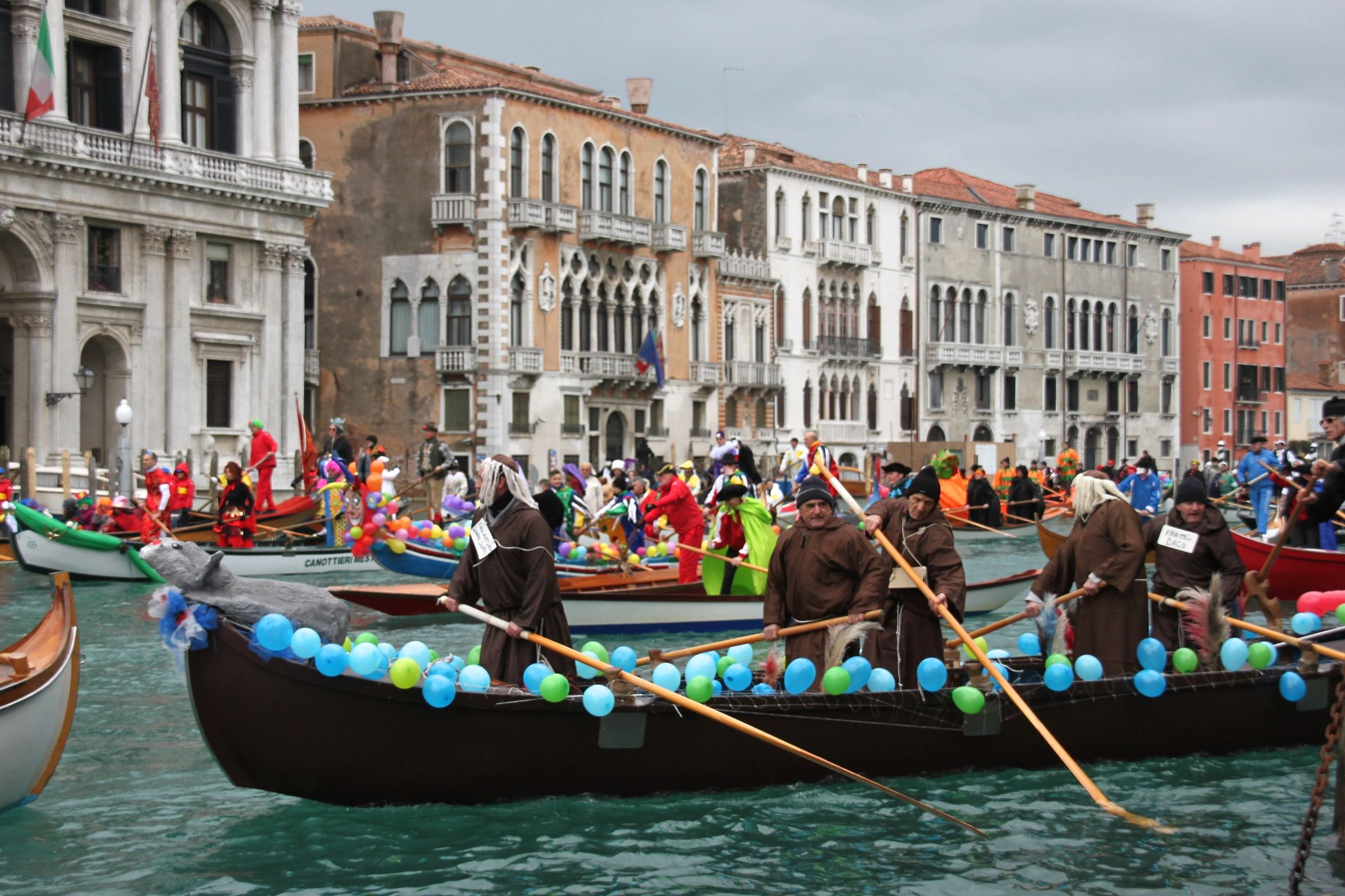 Venice Carnival Water Parade - a crew of men dressed as monks rows down the Grand Canal