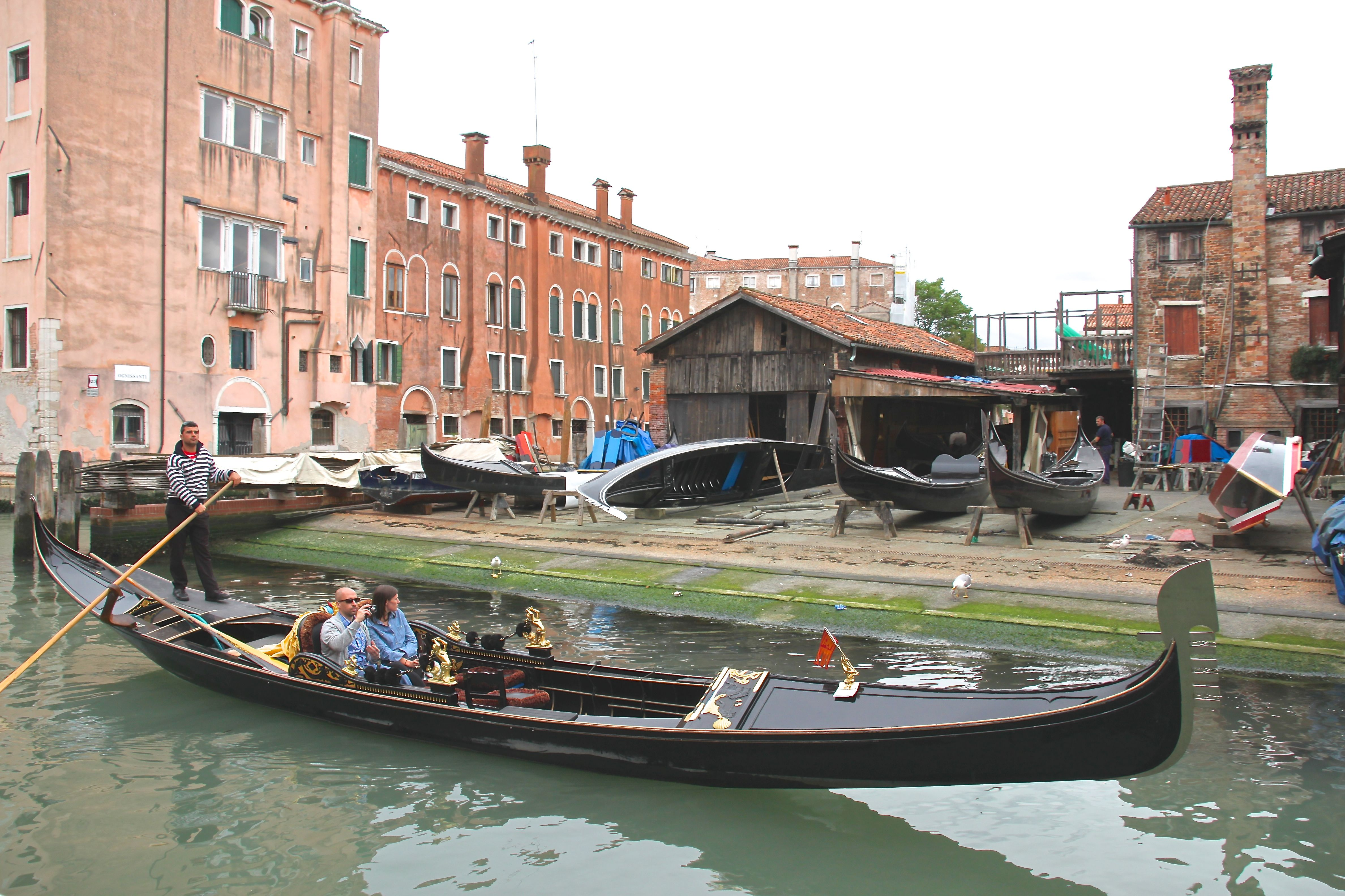 A classic gondola glides past one of the last remaining boatyards in the city