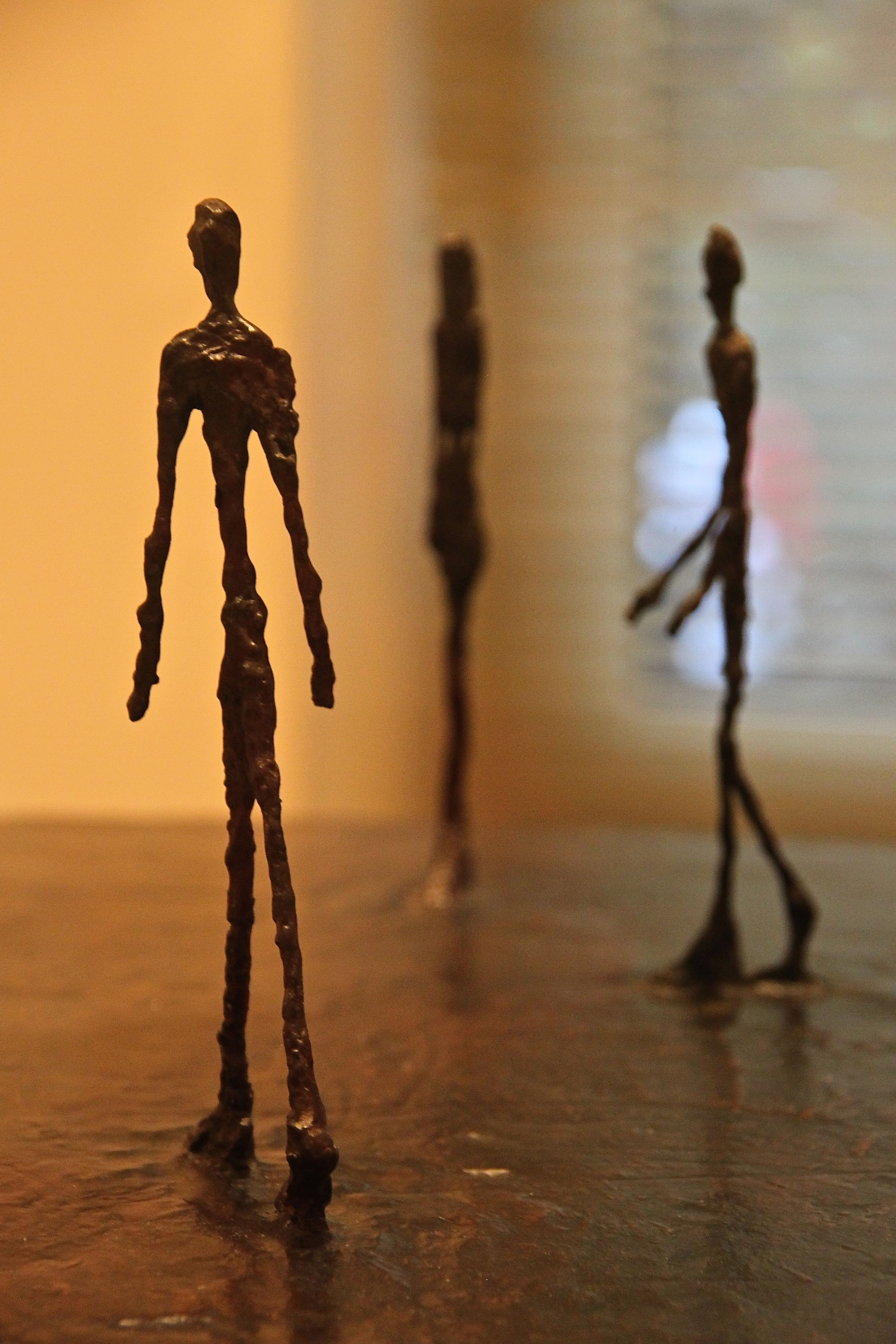 Photo of 3 Alberto Giacometti walking stick men at the Peggy Guggenheim Museum, Venice, Italy