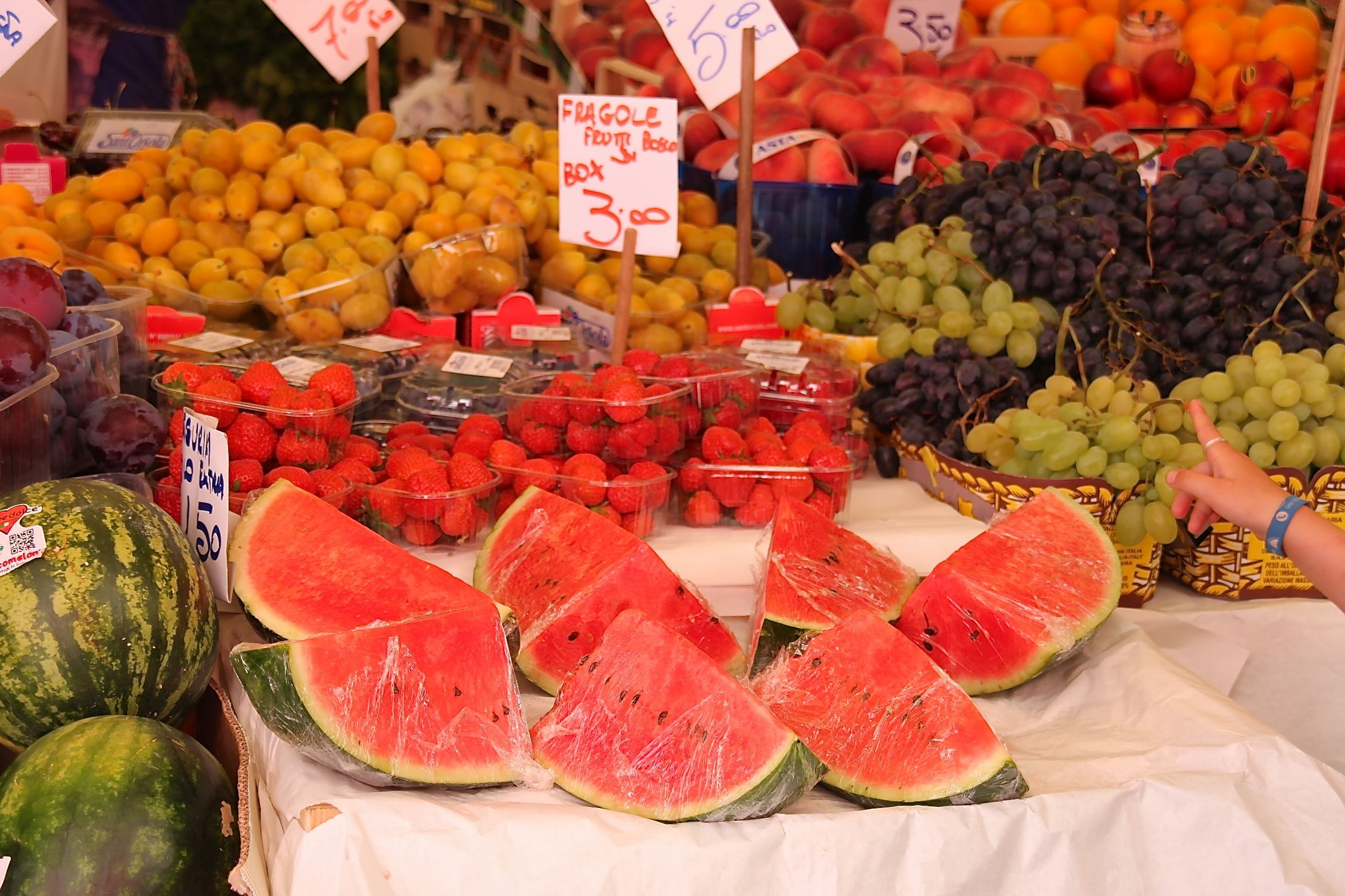 Photo of large watermelon slices in the Rialto market, Venice, Italy