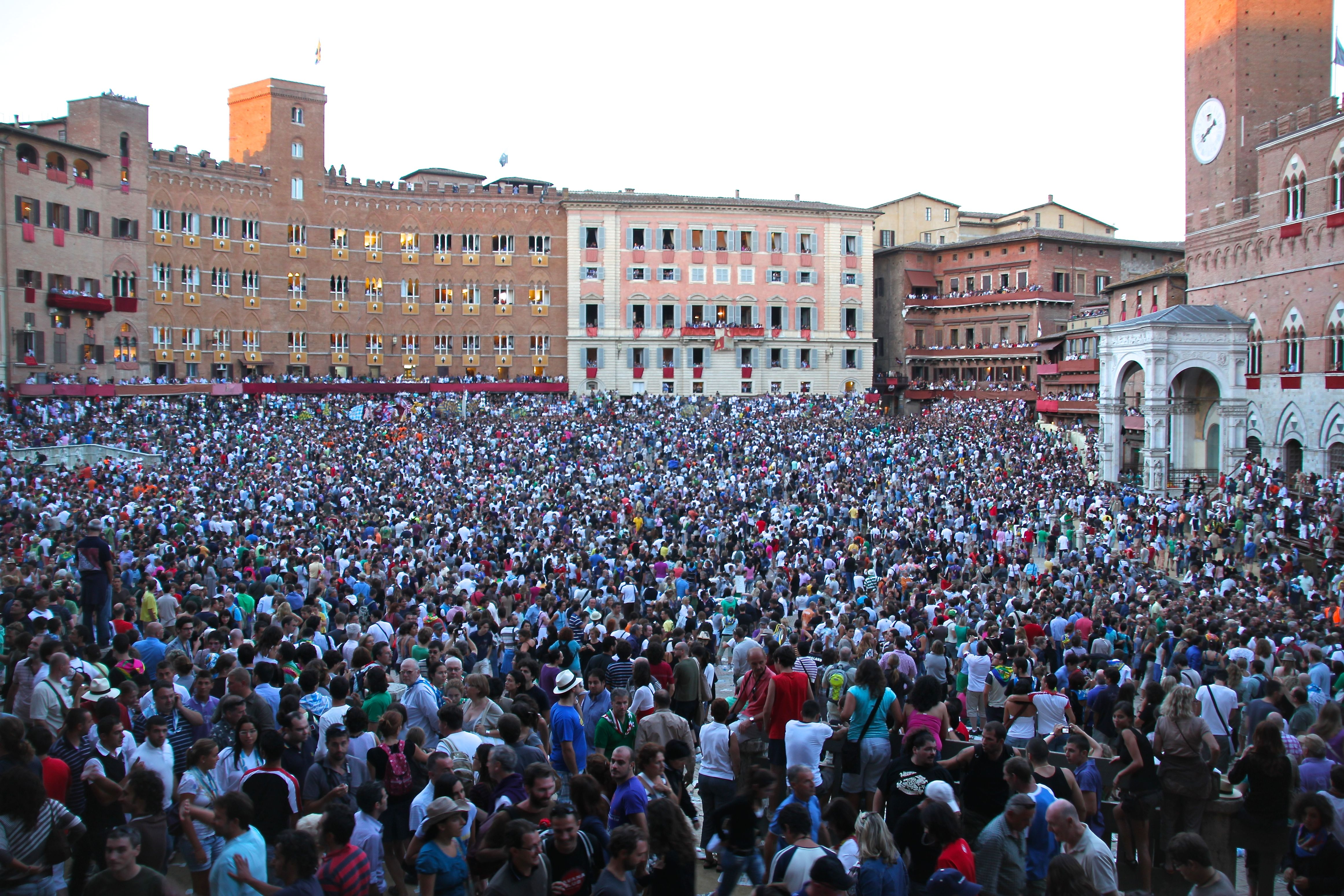 Over 40,000 people are packed into Siena's famous Piazza del Campo to watch the Palio horse race