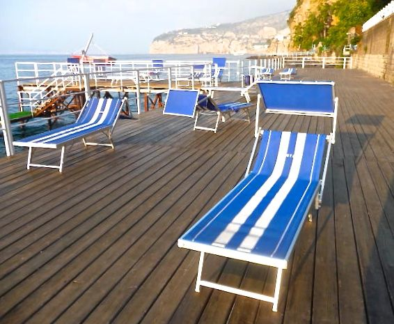 Photo of empty sun loungers on a sun deck in Sorrento, Italy