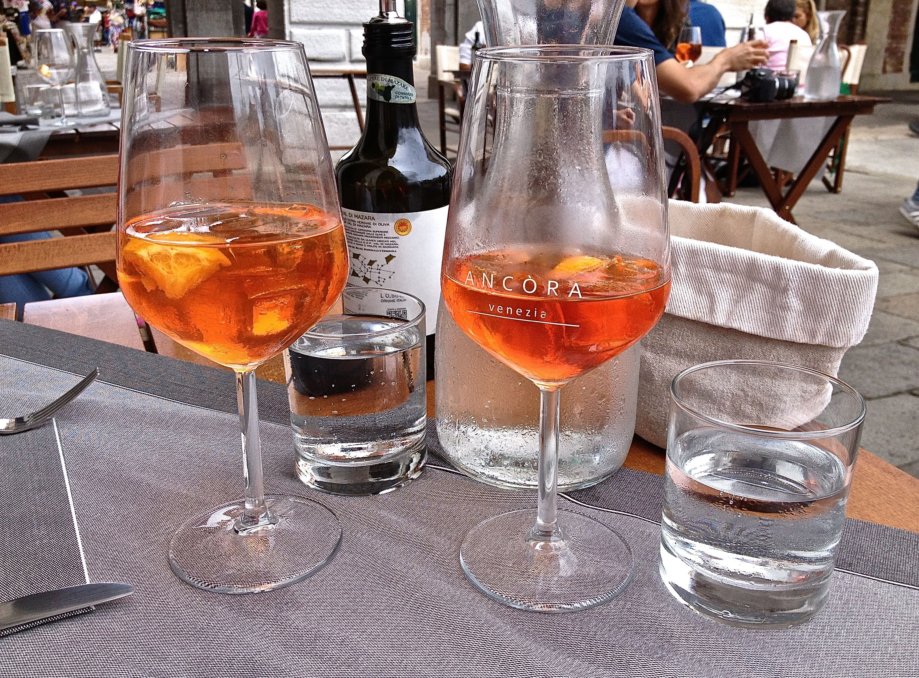 Photo of two Aperol spritz aperitifs in Venice