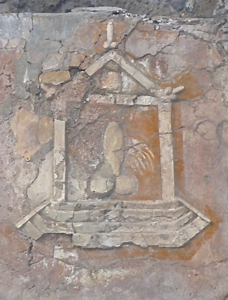 An painting of an altar, possibly Priapus the god of sex and fertility, depicting a large phallus for good luck