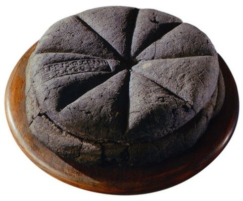 Charred bread excavated from the ancient Roman city of Pompeii still shows the maker's mark