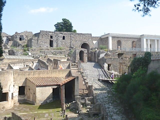 Entering the city of Pompeii via a long stone ramp up to a stone gate just as the ancient Romans would have done in 79 AD