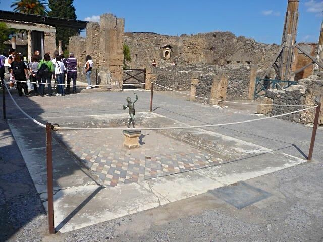 A simple garden pond survives intact at ancient Pompeii together with its small copper statue