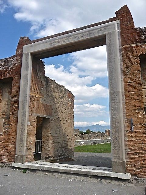 The grand entrance to ancient Pompeii's market is decorated with a finely carved marble door frame