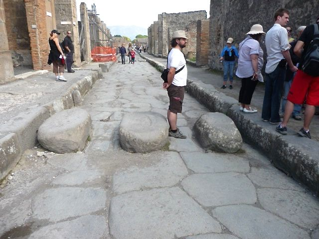 Pompeii streets often included stepping stones so pedestrians could cross easily avoiding animal muck, mud and puddles. The gaps in the stones were perfectly spaced to allow cart wheels through. Clever eh?