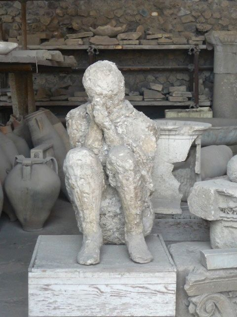 "One of ancient Pompeii's plaster cast figures, nicknamed ""The Thinker"""