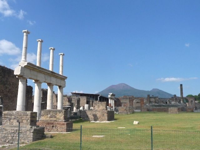 Ruins of the city of Pompeii with the Vesuvius volcano on the horizon