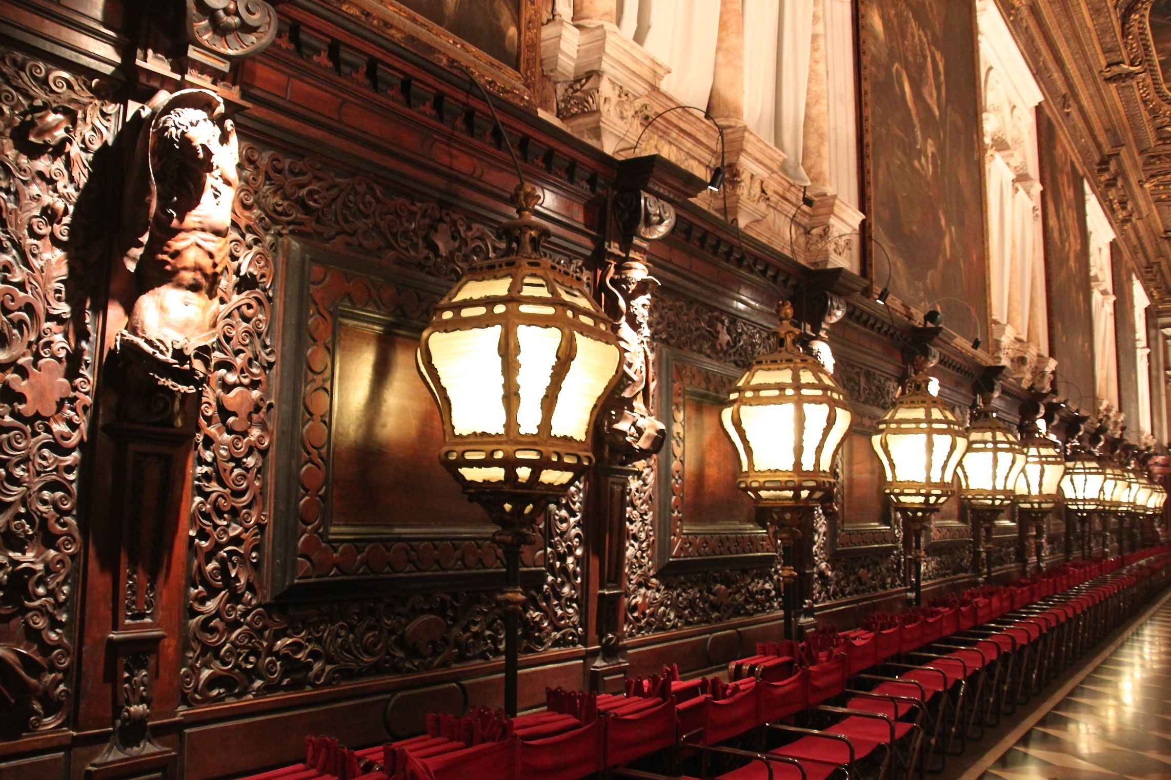 The Scuola Grande di San Rocco is ornately decorated and the main room is softly lit by these huge glass lamps