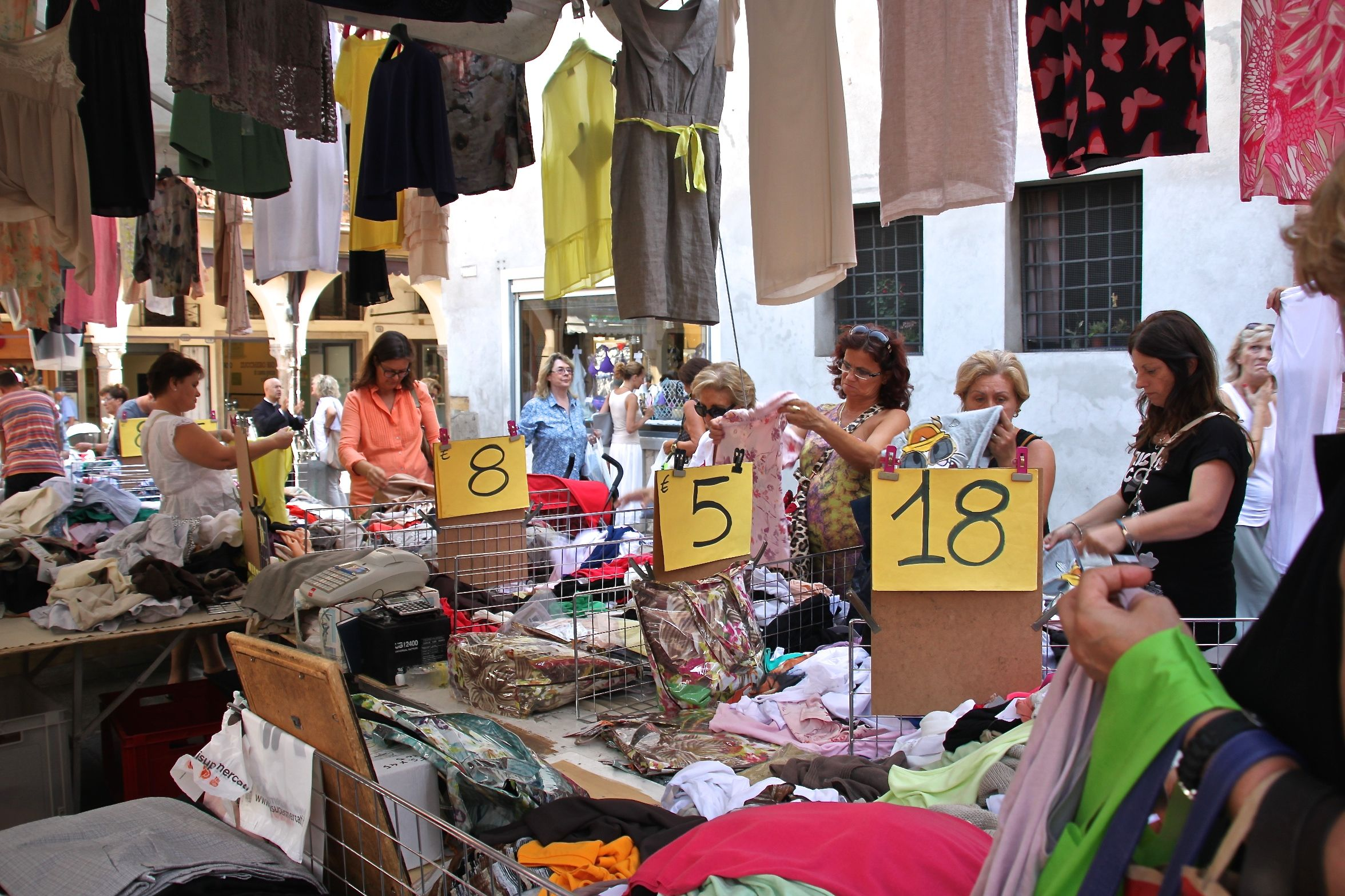 Rummaging for bargains in Padua's clothes market